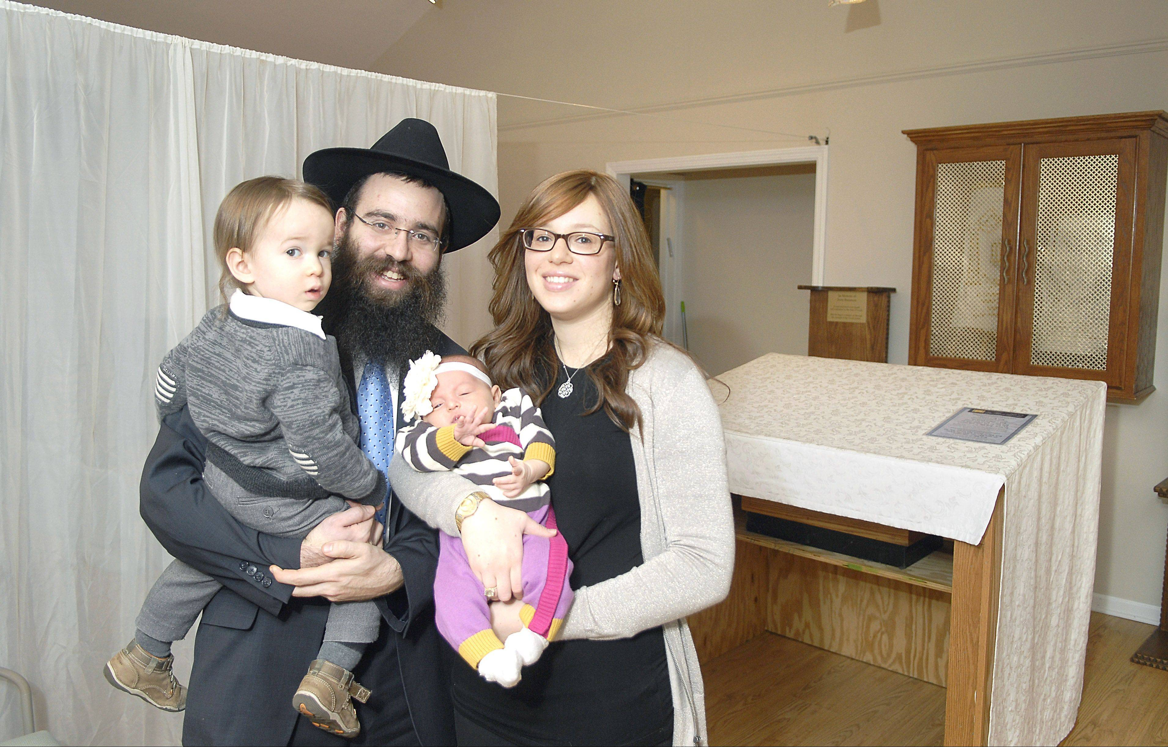 Shemtov, with his wife, Shterna, and their children, Levi and Chaya Mushka.