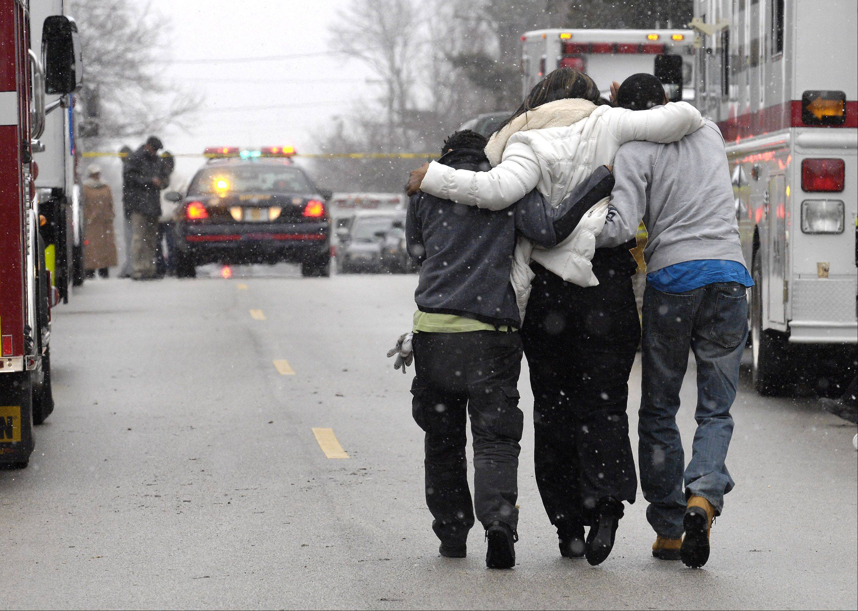 Family members arrive at the scene of a fatal fire on Summit Avenue in unincorporated Dupage County near Oakbrook Terrace. Investigators from the DuPage County Sheriff, ATF, and local fire departments were on the scene to investigate suspicious fatal fire that claimed the lives of four people .
