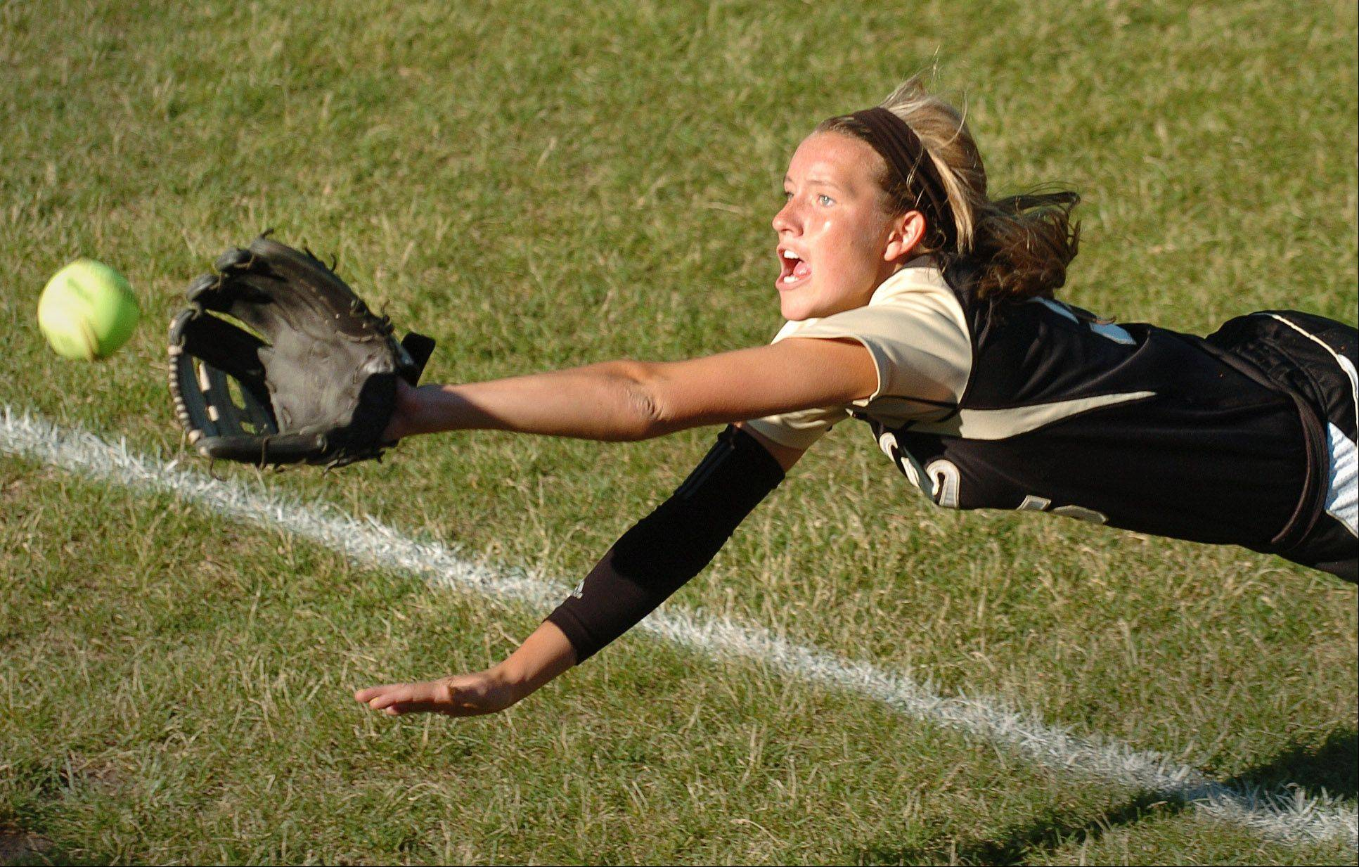 Jordyn Bowen of Grayslake North reaches for a foul ball at the Grayslake North vs. Marengo girls softball game as part of the state tournament in DeKalb.
