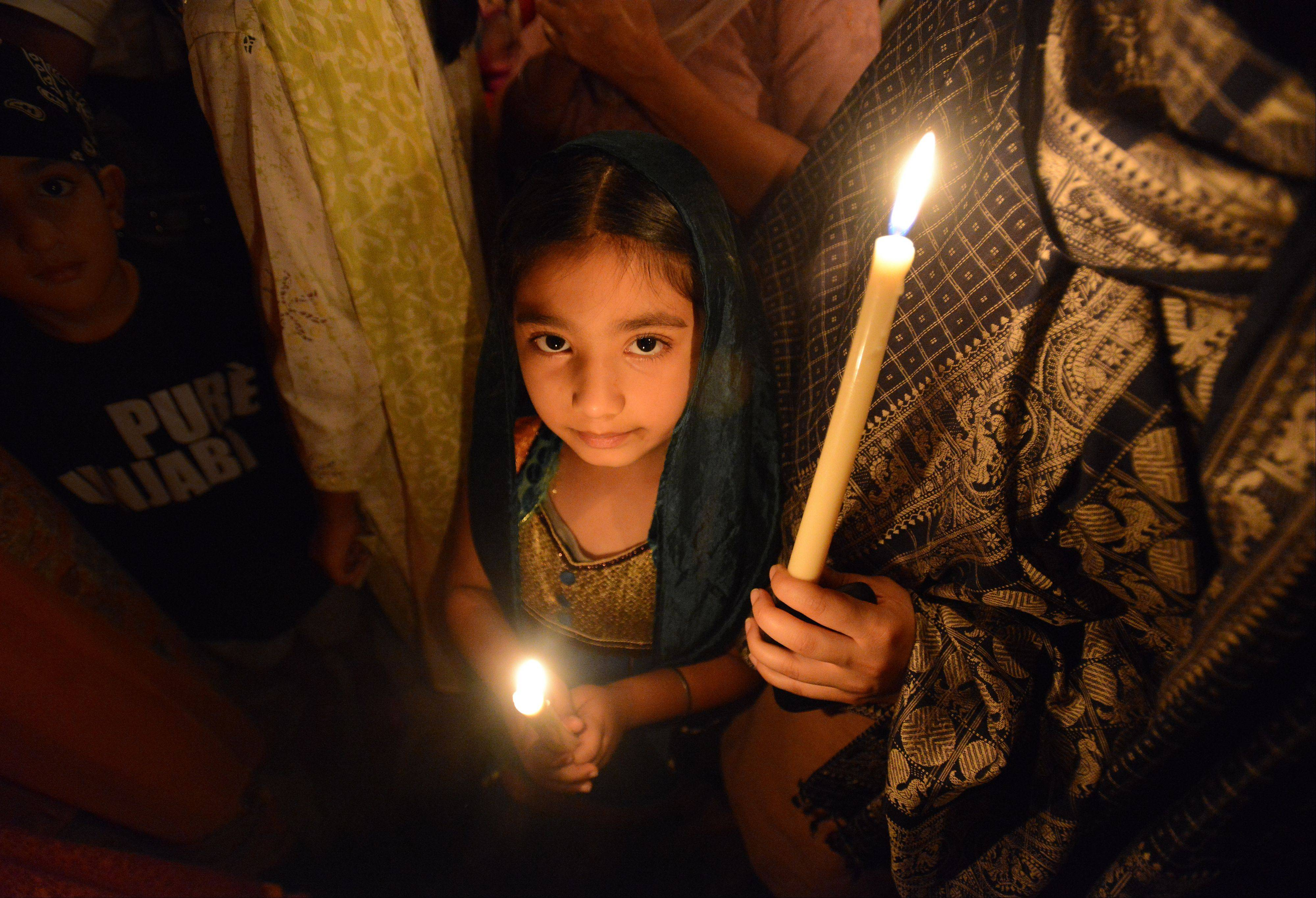 Young and old came to the candlelight vigil held in Palatine at the Sikh Religious Society temple to pray and remember those who were killed in a Wisconsin Sikh temple shooting.