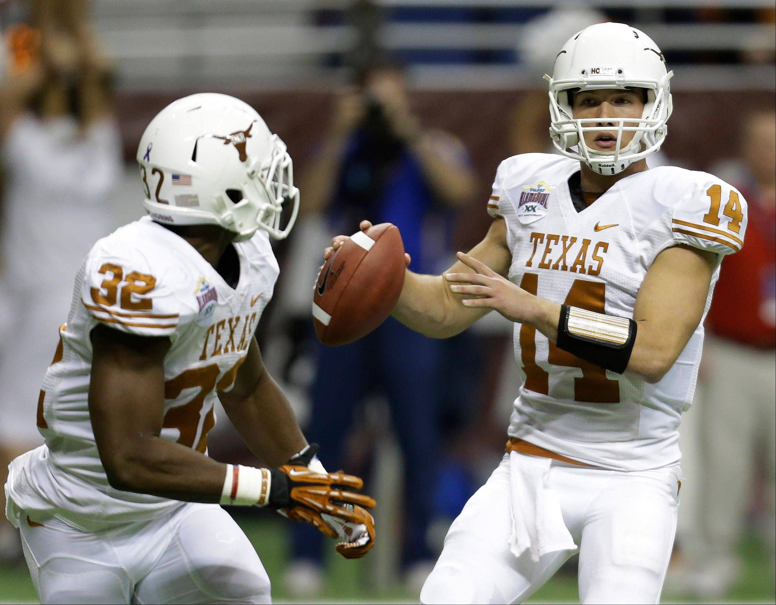 Texas' David Ash (14) looks to pass to Johnathan Gray (32) during the first quarter of the Alamo Bowl NCAA football game against Oregon State, Saturday, Dec. 29, 2012, in San Antonio.