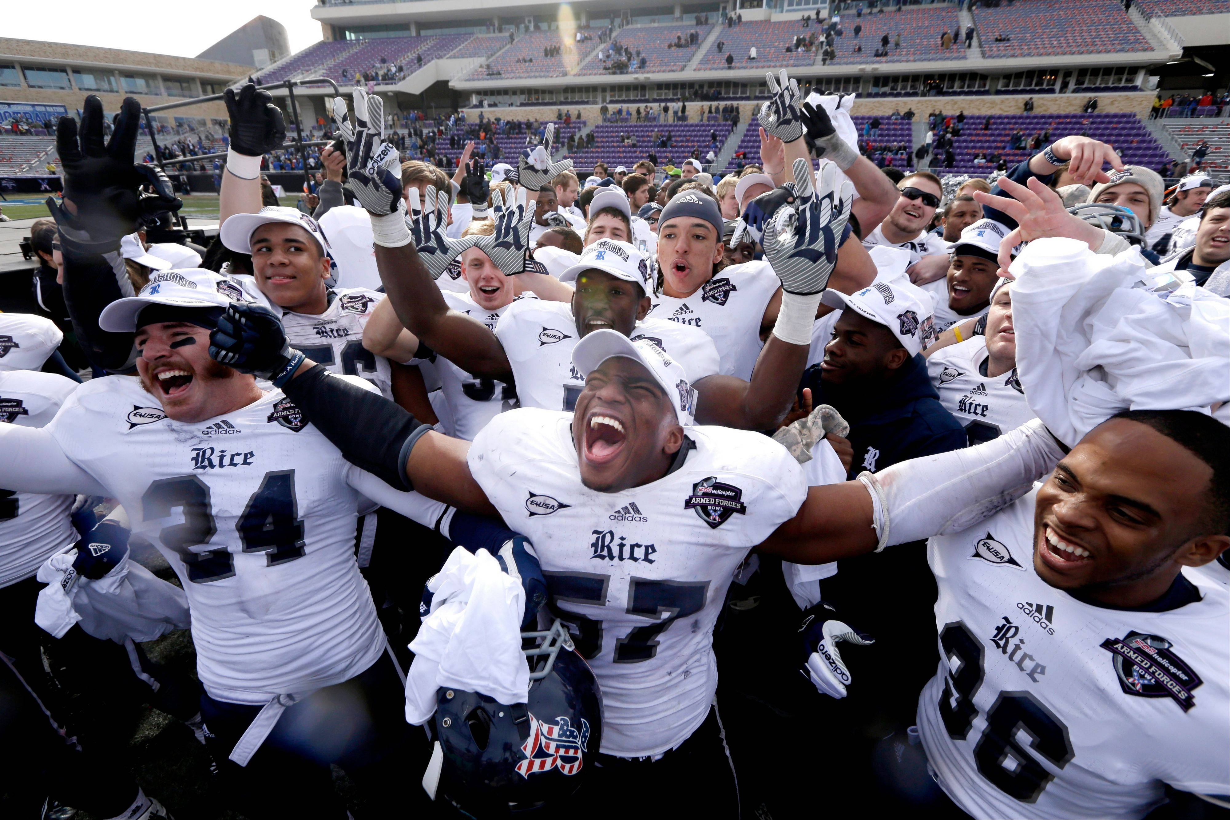 Rice linebacker Cameron Nwosu (57) celebrates with safety Paul Porras (24) and defensive end Dylan Klare (96) Saturday after the Armed Forces Bowl against Air Force in Fort Worth, Texas. Rice won 33-14.