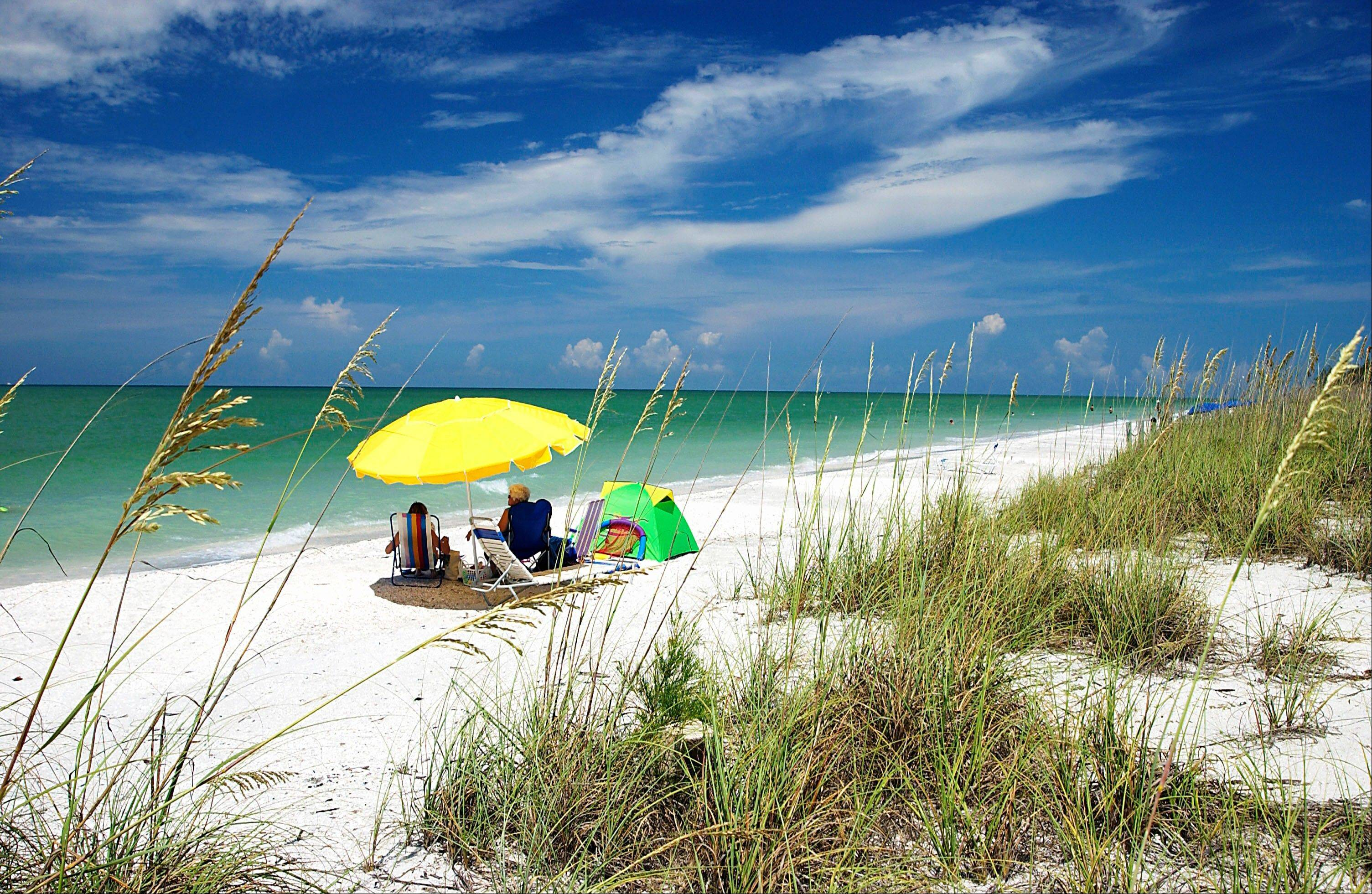 Visitors enjoy West Gulf Beach on Sanibel Island in Florida.