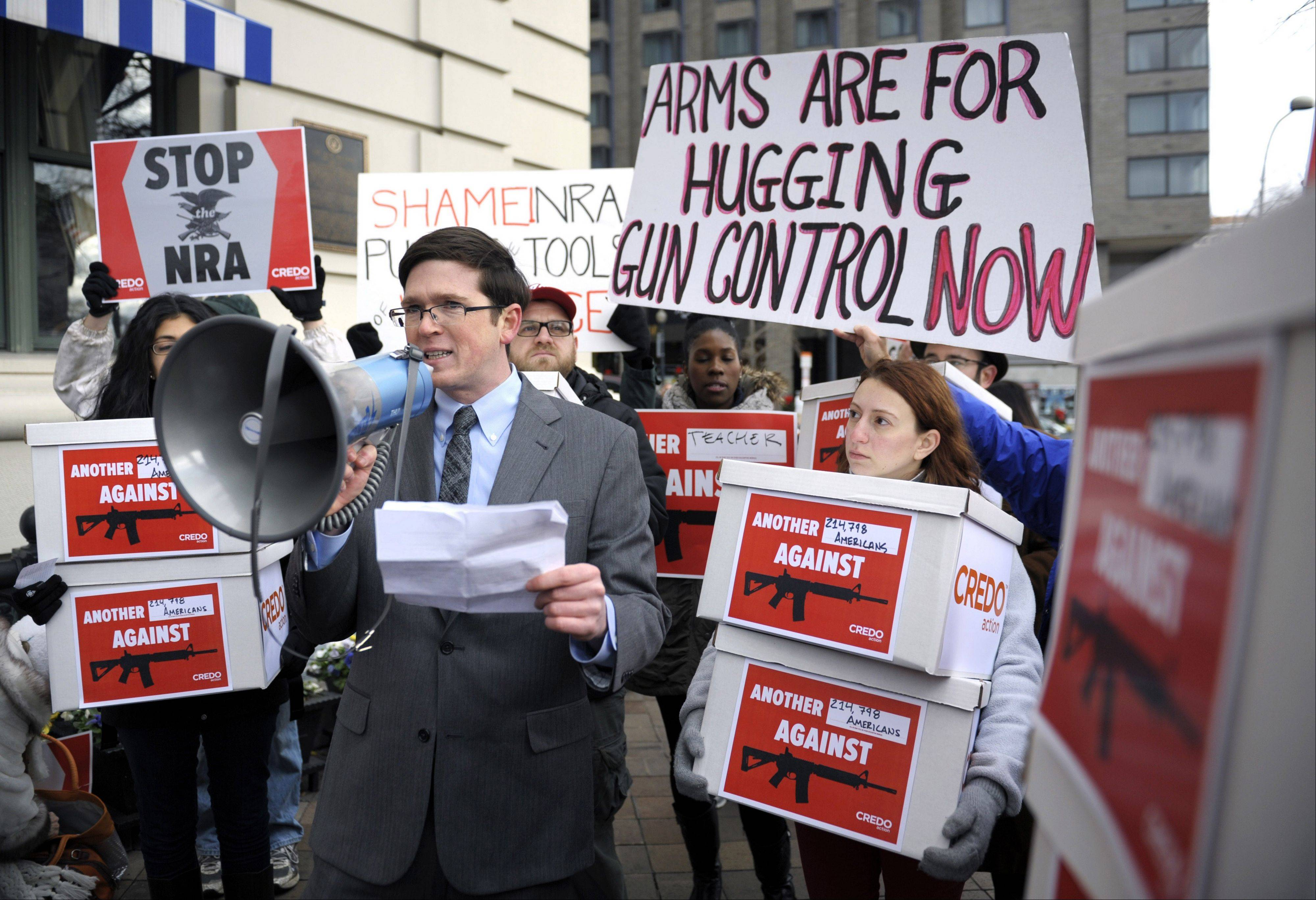 Josh Nelson, campaign manager, CREDO Mobile, speaks Dec. 21 after his group was denied entrance to a Washington hotel where they wanted to deliver a petition to the National Rifle Association calling for the NRA to get out of the way of gun control.