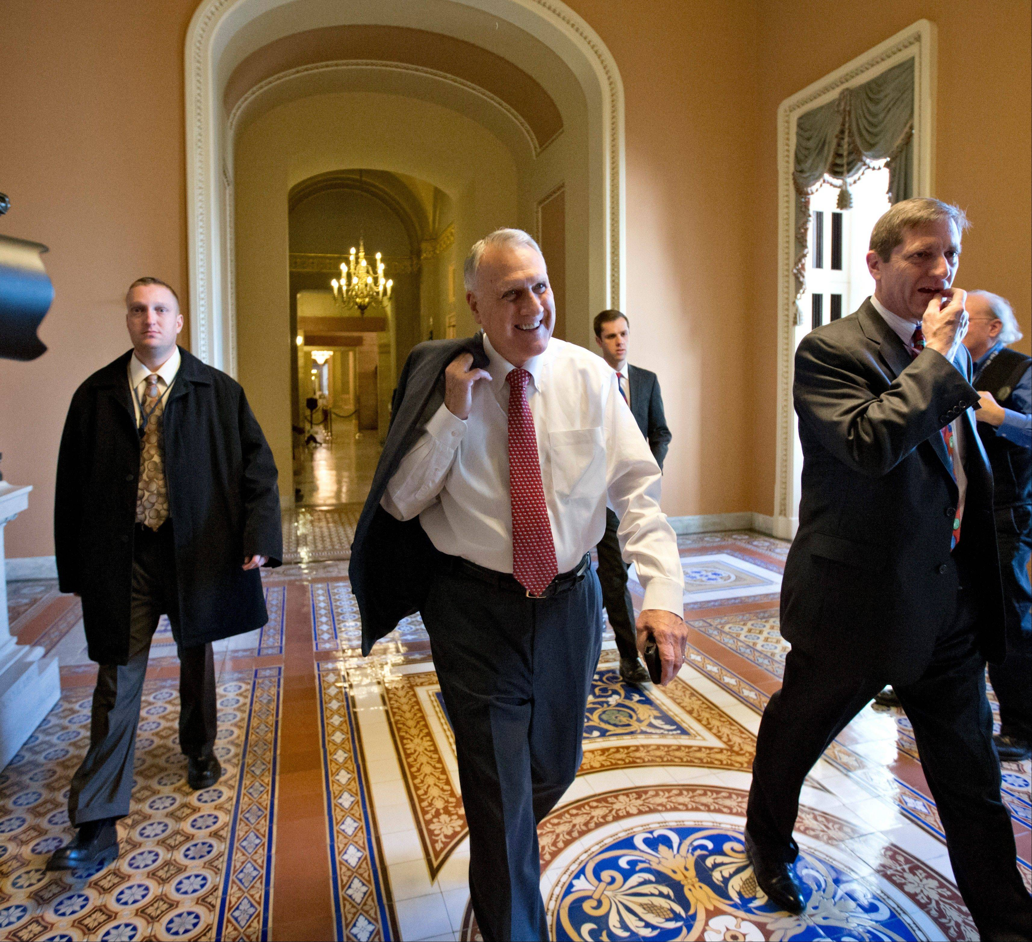 "Senate Minority Whip Jon Kyl of Arizona walks between the Senate chamber and the office of Senate Minority Leader Mitch McConnell of Kentucky, as Democrats and Republicans try to negotiate a legislative path to avoid the so-called ""fiscal cliff"" Sunday."