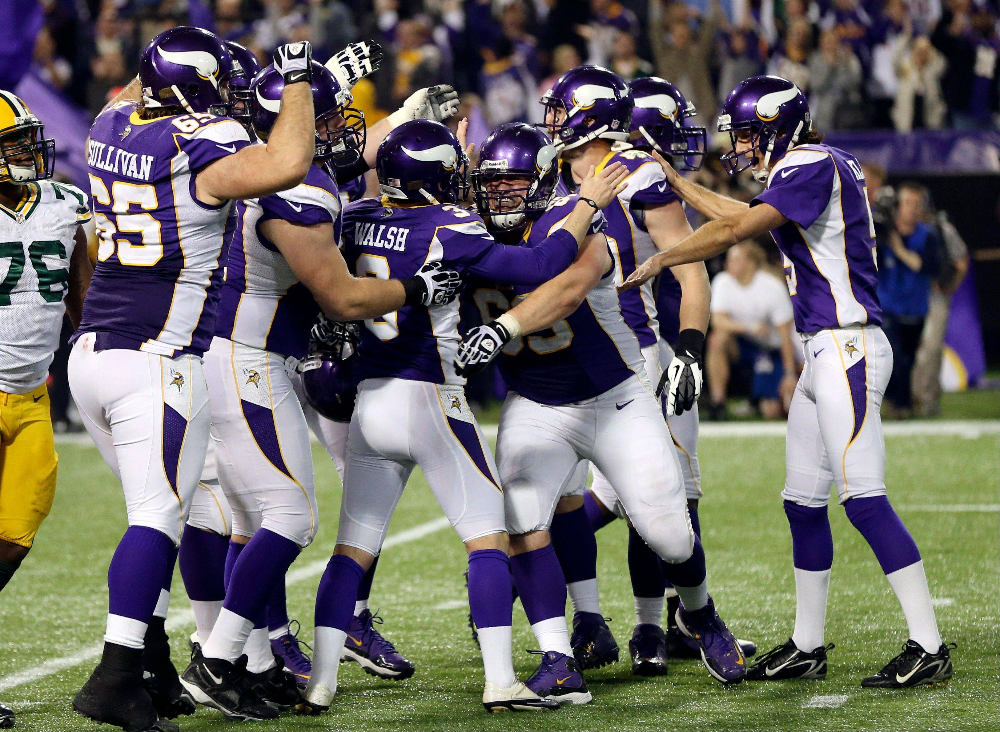 Minnesota Vikings kicker Blair Walsh, middle, celebrates with teammates after kicking a 29-yard field goal to knock the Bears out of the playoff picture. But will that be enough to determine the fate of Bears coach Lovie Smith?