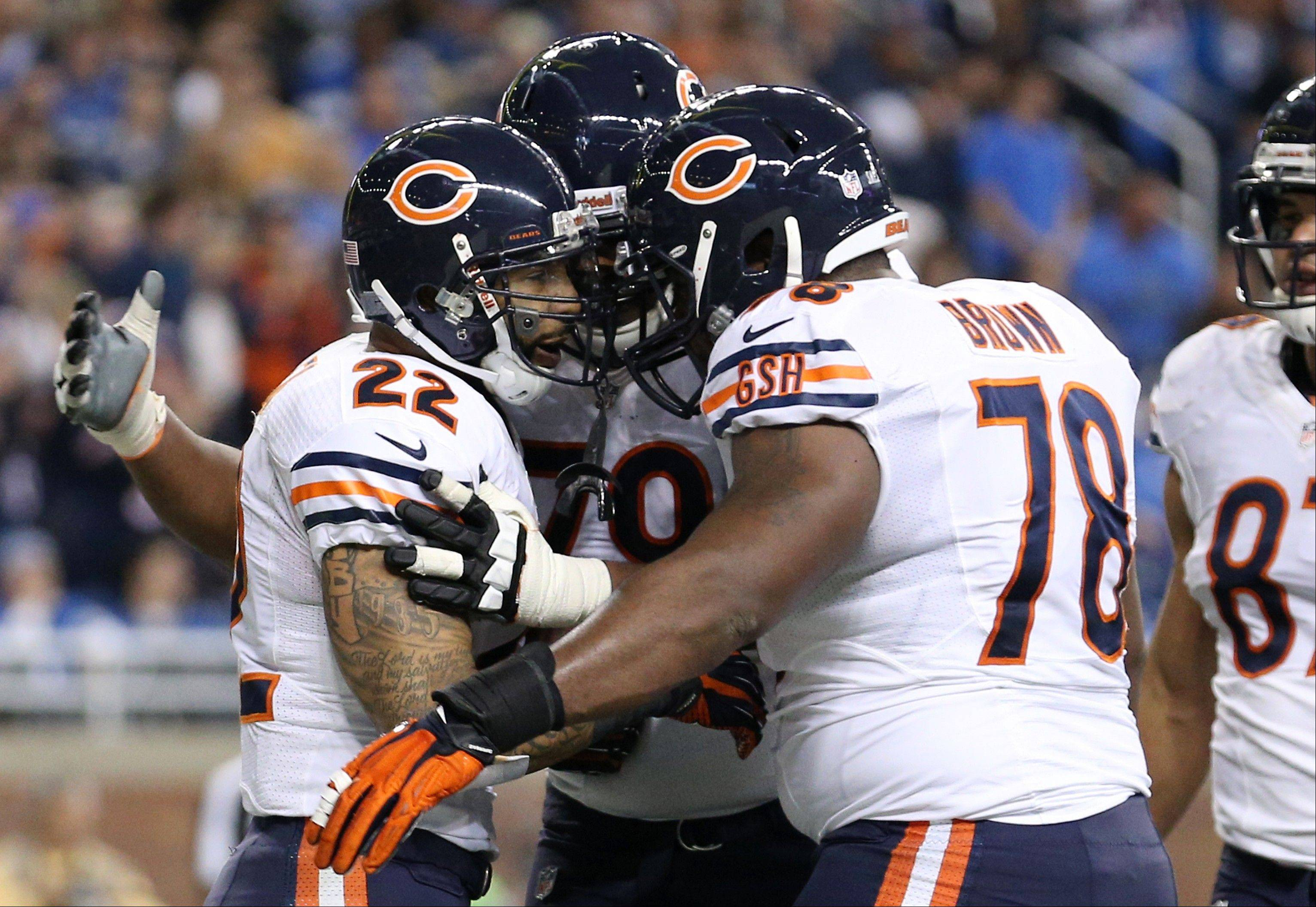 Bears running back Matt Forte is congratulated by teammates after his 1-yard touchdown during the second quarter of an NFL football game against the Detroit Lions at Ford Field in Detroit, Sunday, Dec. 30, 2012.