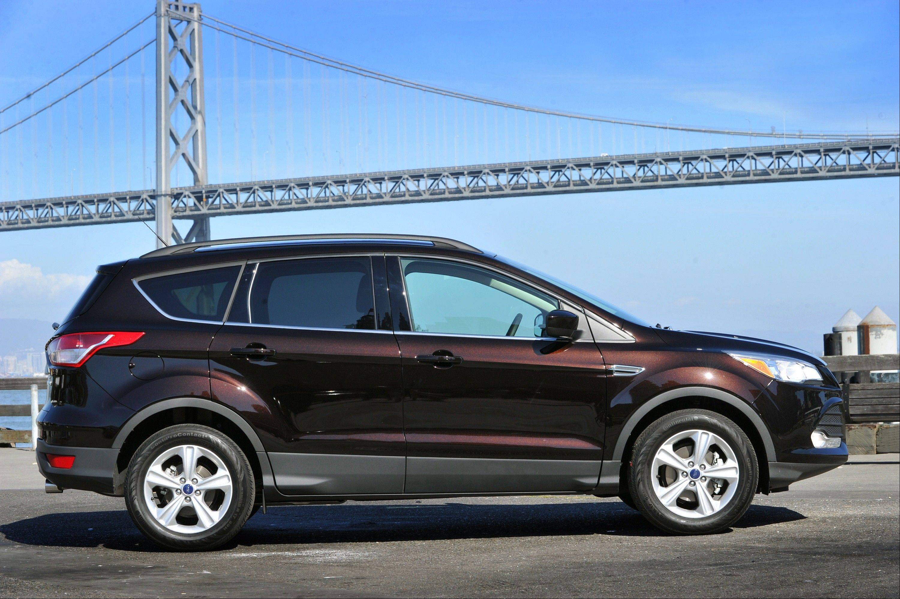 The all-new 2013 Ford Escape is seen above. Ford said 2012 will be the second year in a row it will sell more than 2 million cars.