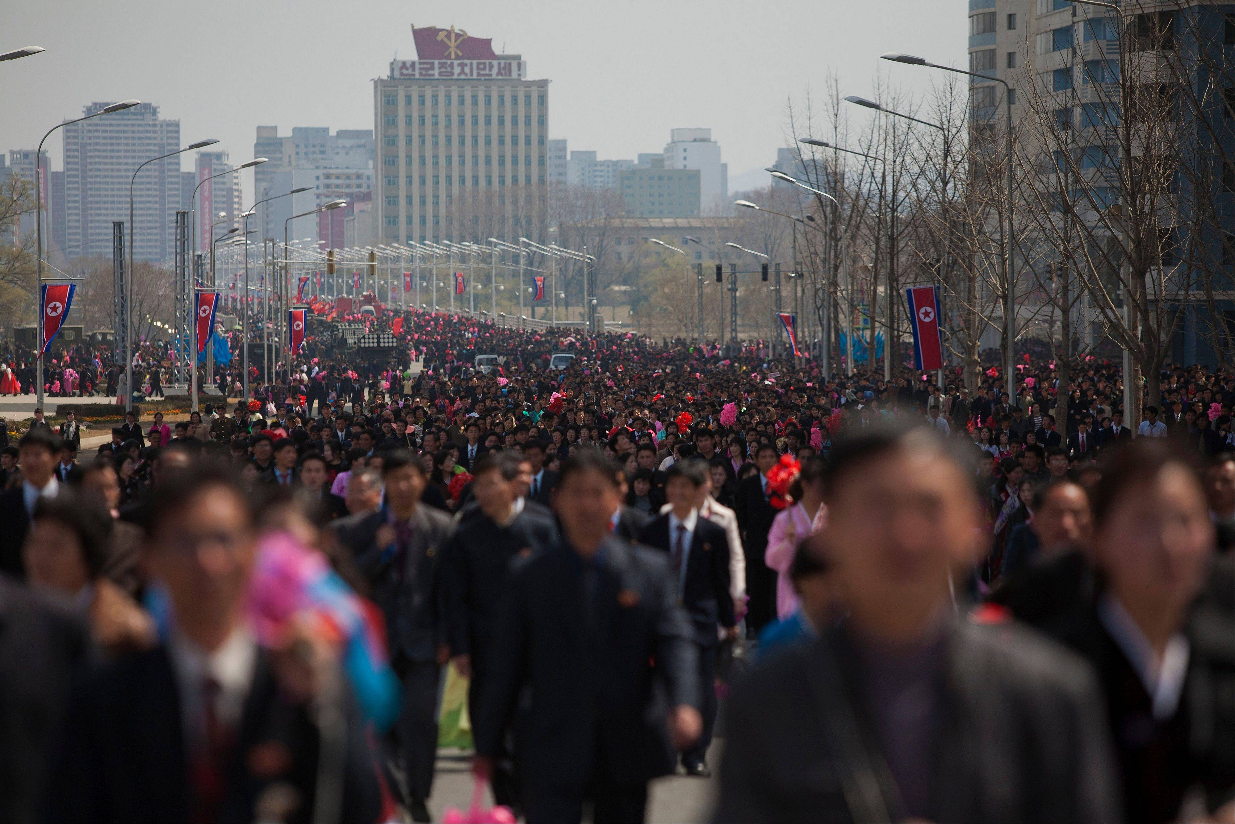 People walk down a street after a large military parade in Pyongyang's Kim Il Sung Square celebrating 100 years since the birth of the late North Korean founder Kim Il Sung.