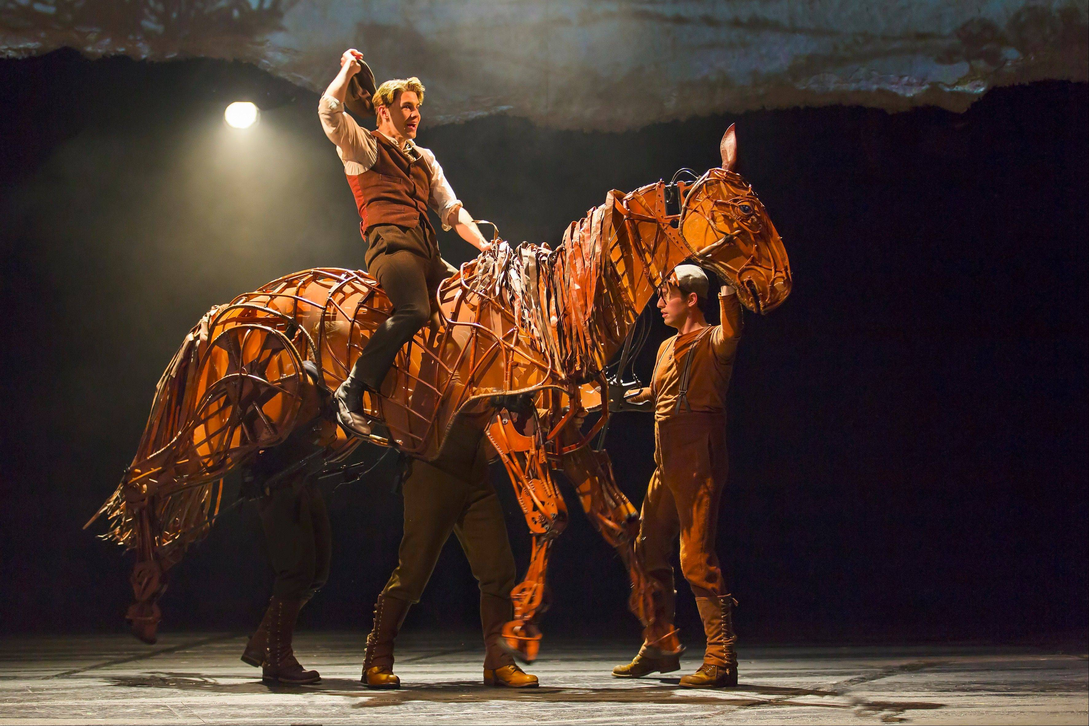 "Albert (Andrew Veenstra) rides his family's horse, Joey (manipulated by John Riddleberger, Patrick Osteen and Jessica Krueger), in the North American tour of ""War Horse,"" playing at Chicago's Cadillac Palace Theatre."
