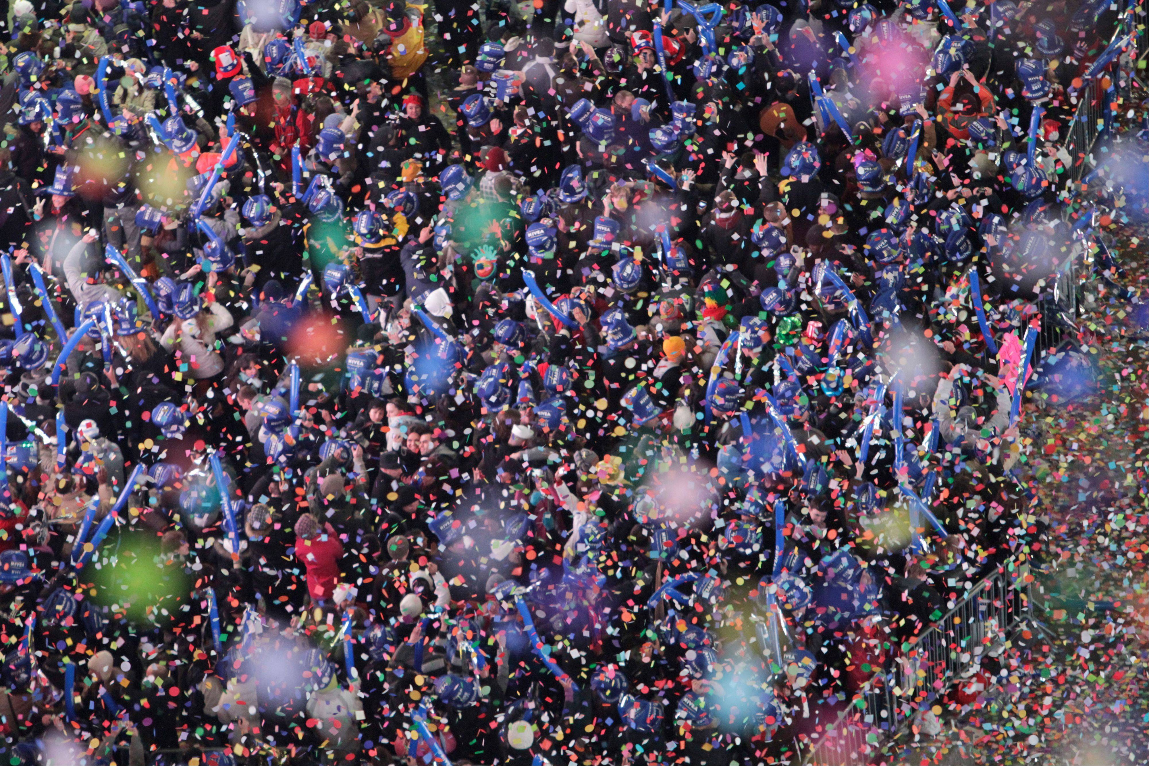 Confetti falls over revelers in New York's Times Square as the clock strikes midnight during a New Year's Eve celebration. The holidays often mean an excess of booze and drugs.
