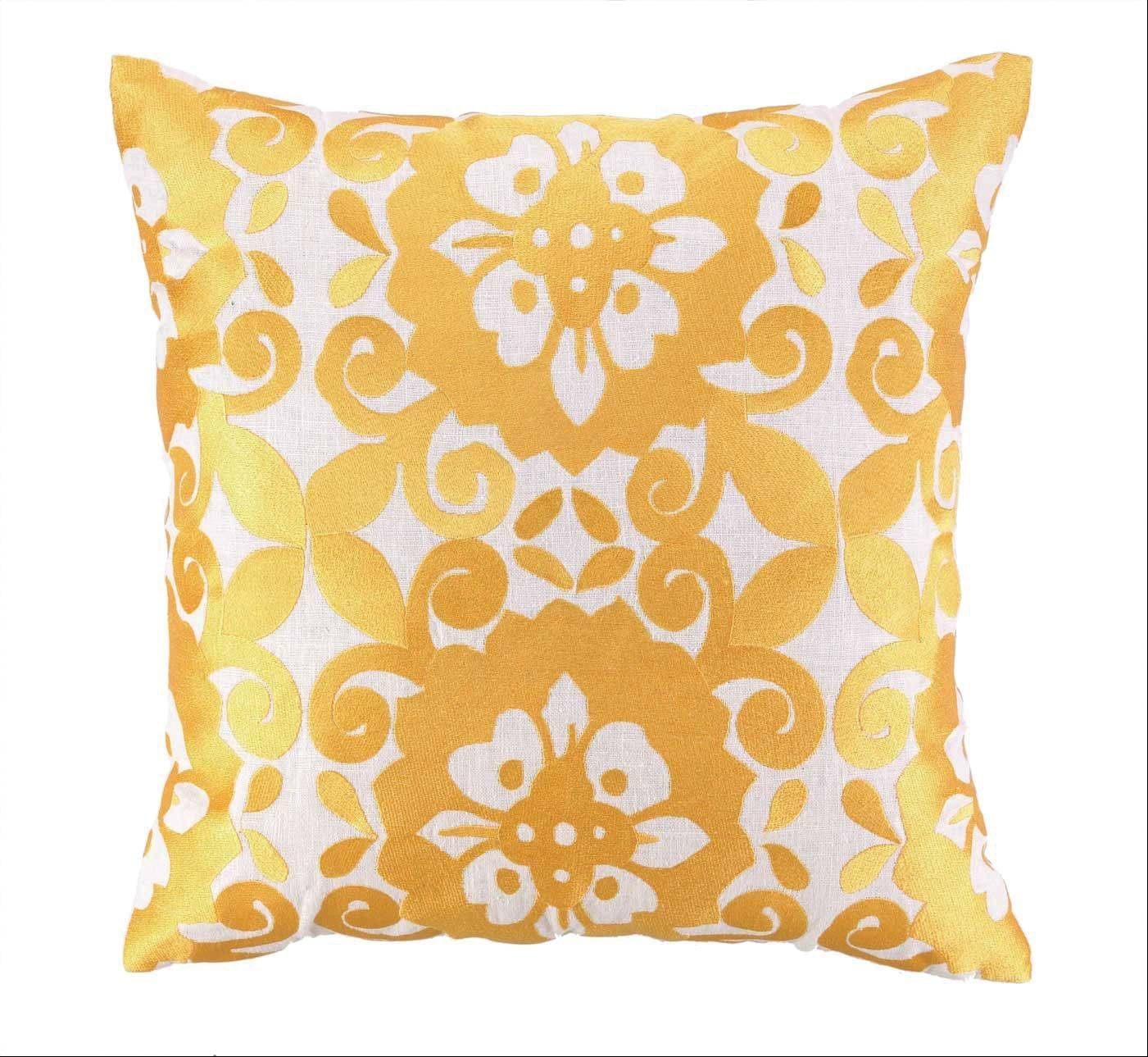 Gold futures: A metallic yellow pillow adds a pop of color and shine.