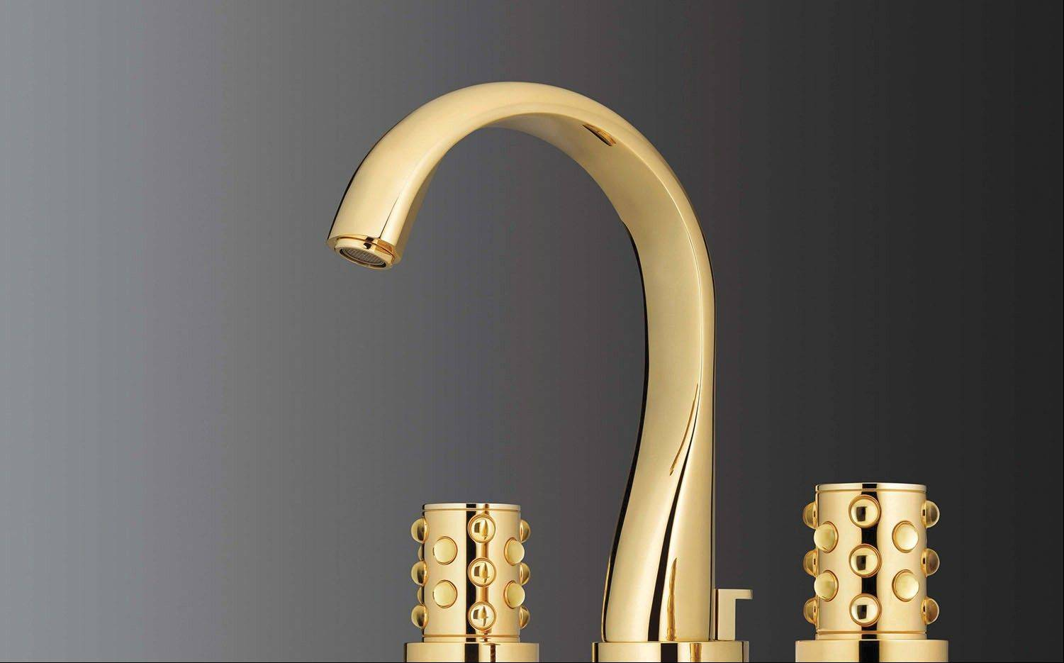 In the bath, a sculptural faucet demonstrates the regal, contemporary look of gold.