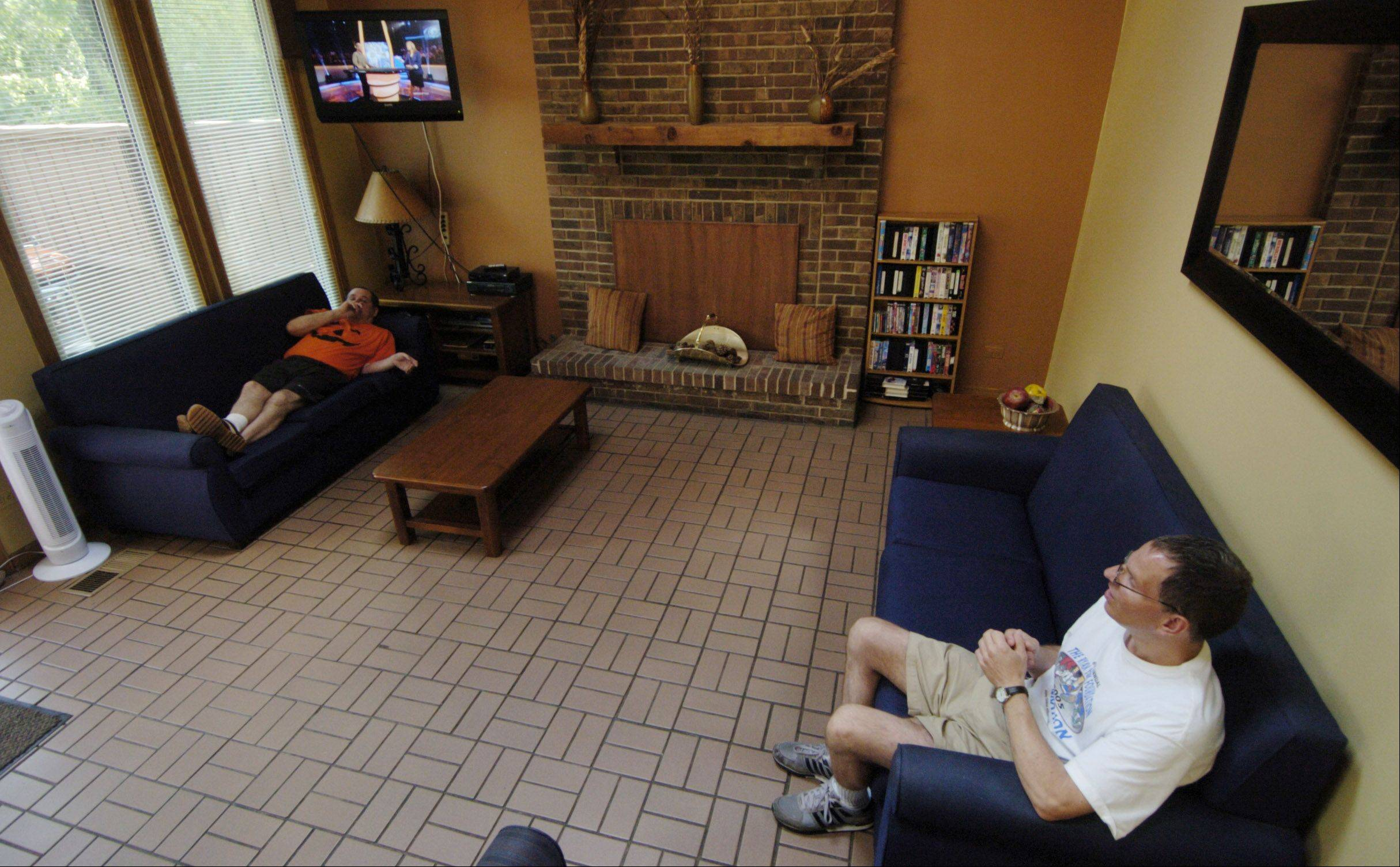 Residents relax in the living room of a Little City group home in Palatine for developmentally and intellectually disabled men.
