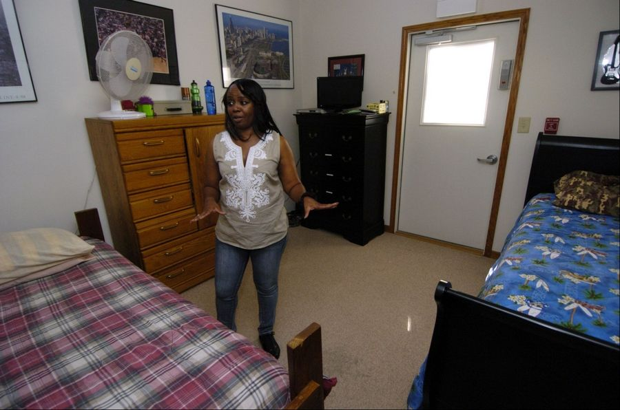 Little City Home Supervisor Darlene Banks talks about living arrangements in a group home in Palatine for developmentally and intellectually disabled men.