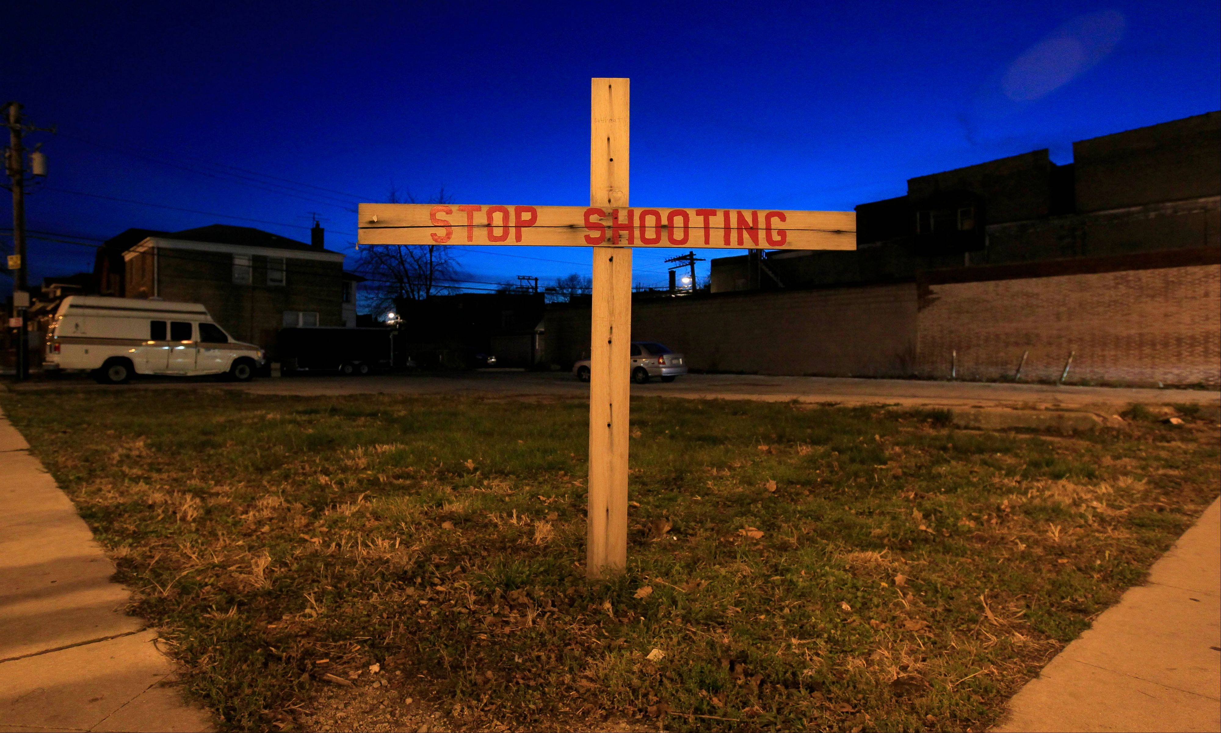 A lone cross stands in a vacant lot on the corner of 79th and Loomis in the Auburn-Gresham neighborhood on Chicago's South Side. Up to 80 percent of Chicago's murders and shootings are gang-related, according to police.