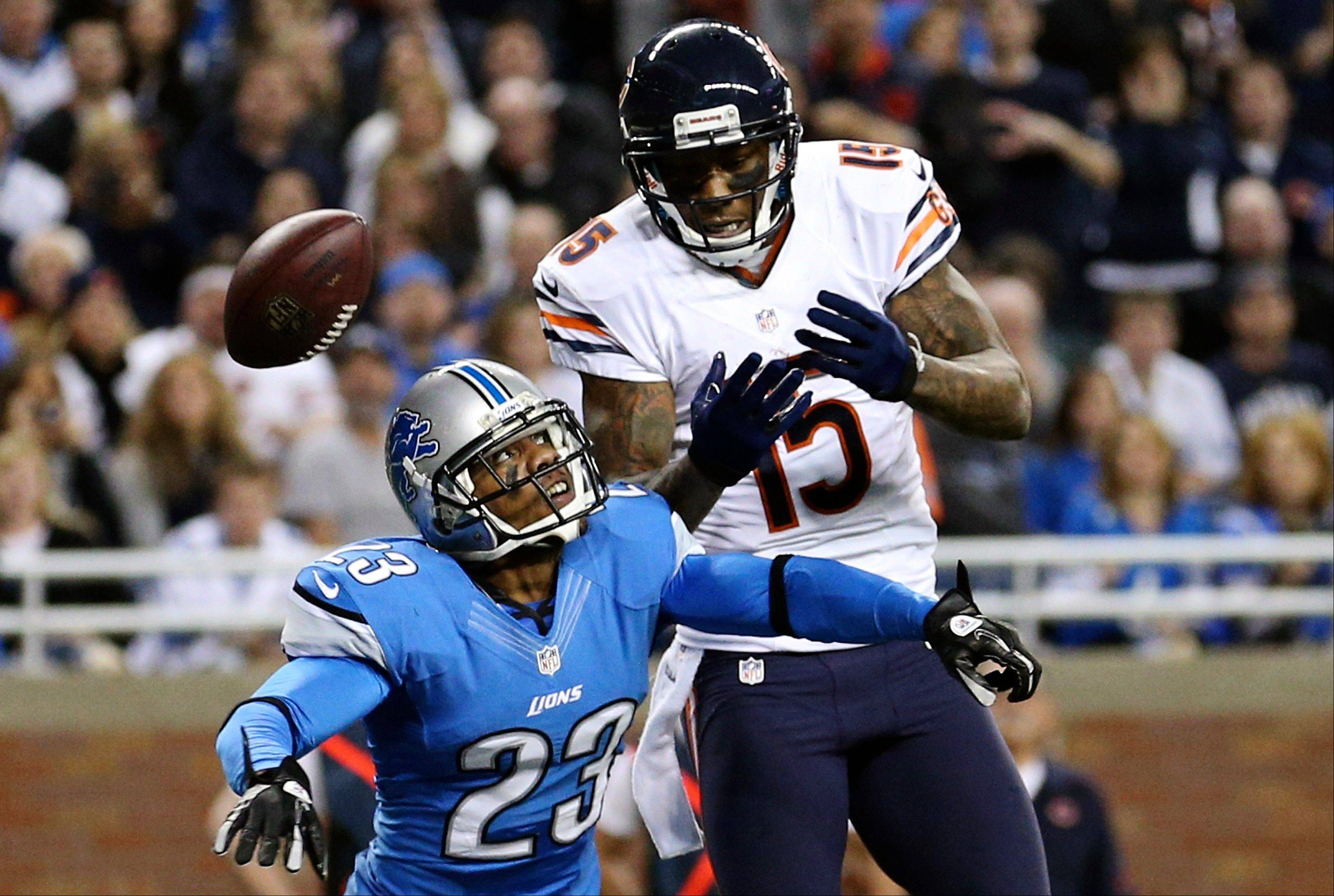 Detroit Lions cornerback Chris Houston breaks up a pass intended for Bears wide receiver Brandon Marshall during the fourth quarter Sunday at Ford Field in Detroit. The Bears won 26-24 but still missed out on the postseason party.