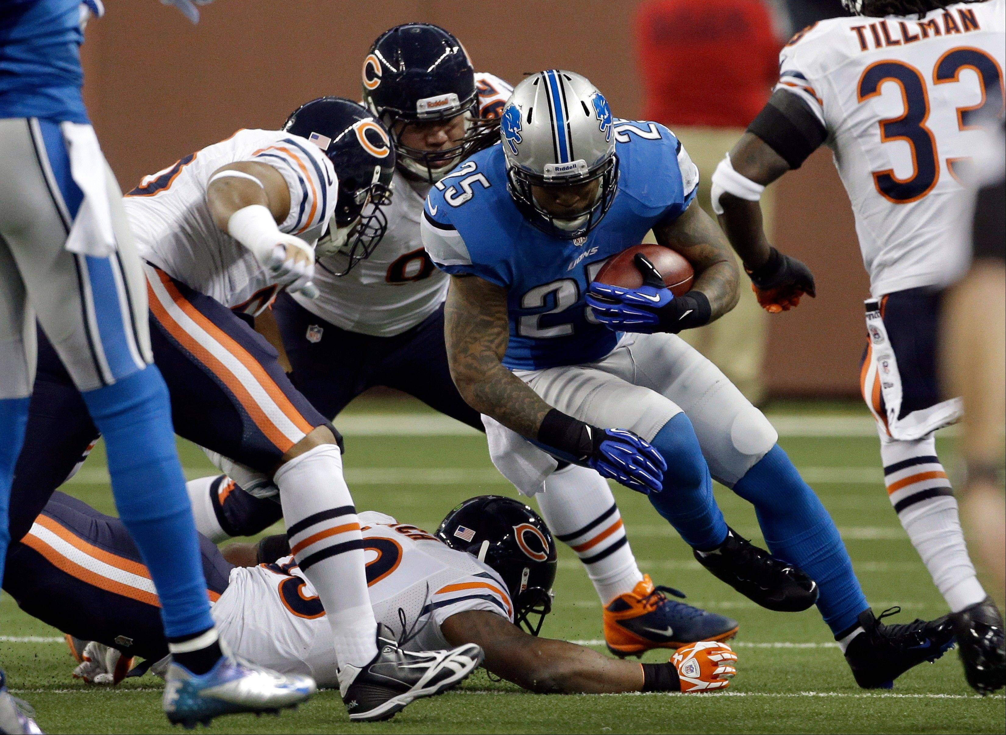Detroit Lions running back Mikel Leshoure (25) is stopped by the Chicago Bears defense during the first quarter.