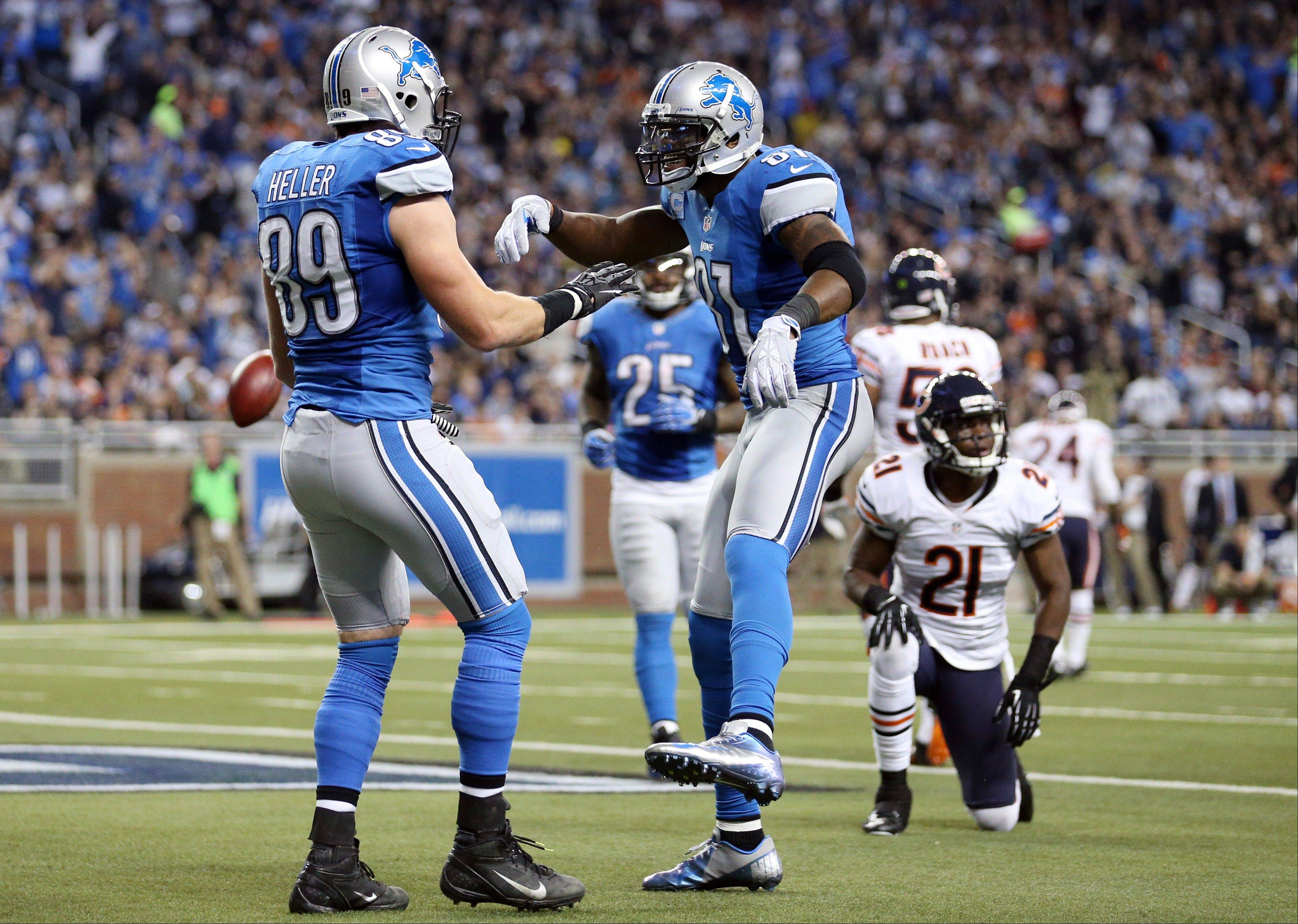 Detroit Lions tight end Will Heller (89) is congratulated by teammate wide receiver Calvin Johnson (81) after his touchdown during the third quarter.