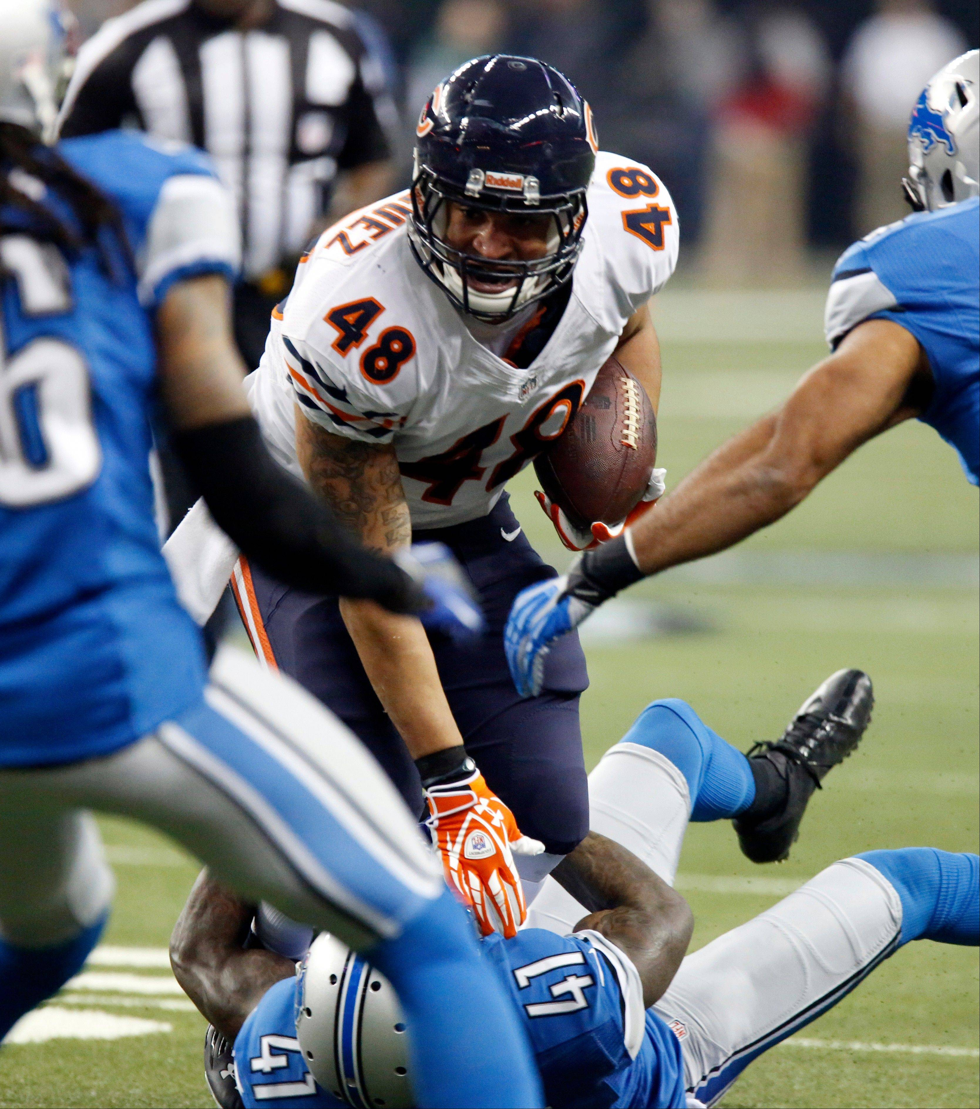 Chicago Bears fullback Evan Rodriguez (48) is stopped by Detroit Lions cornerback Ron Bartell (41) during the first quarter.