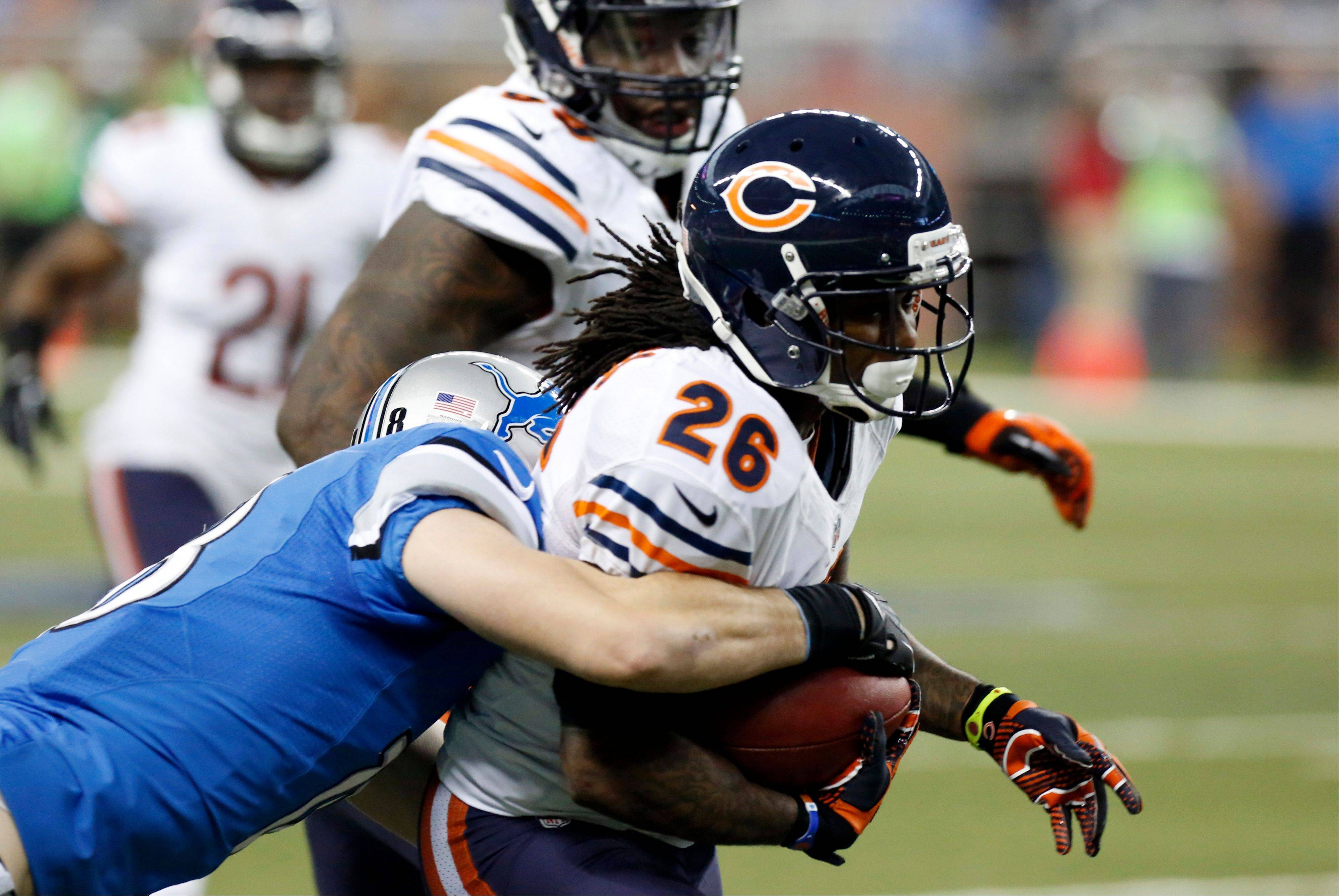 Detroit Lions' Kris Durham stops Chicago Bears cornerback Tim Jennings (26) during the second quarter.