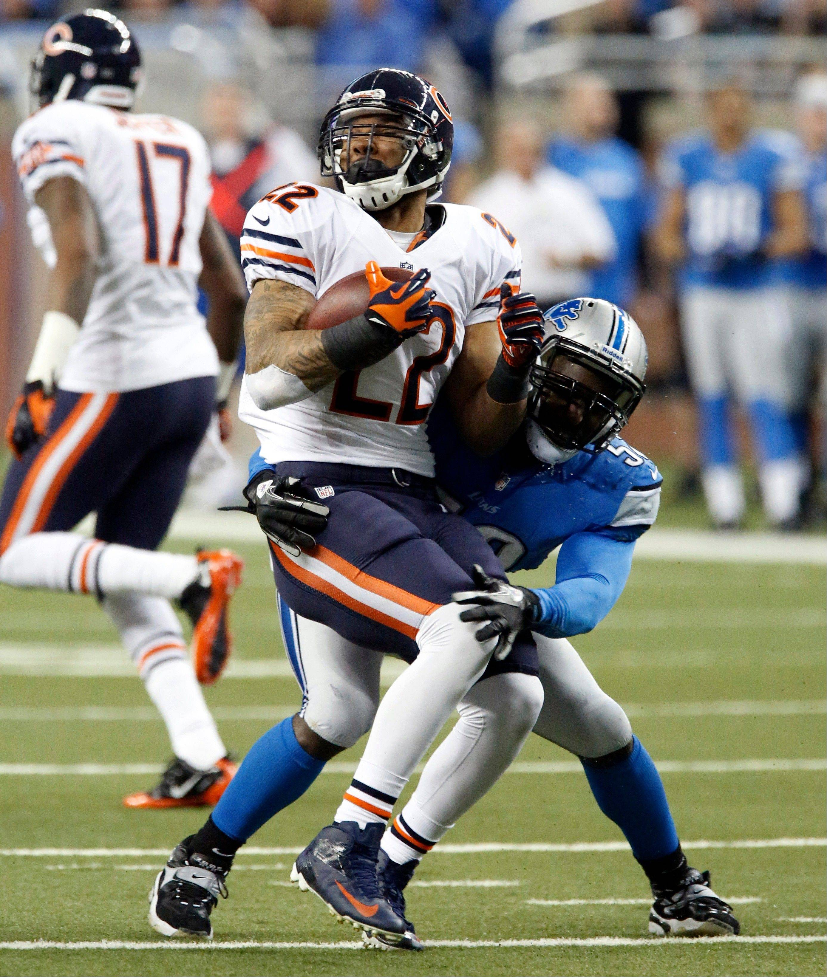 Chicago Bears running back Matt Forte (22) is stopped by Detroit Lions outside linebacker Justin Durant (52) during the first quarter.