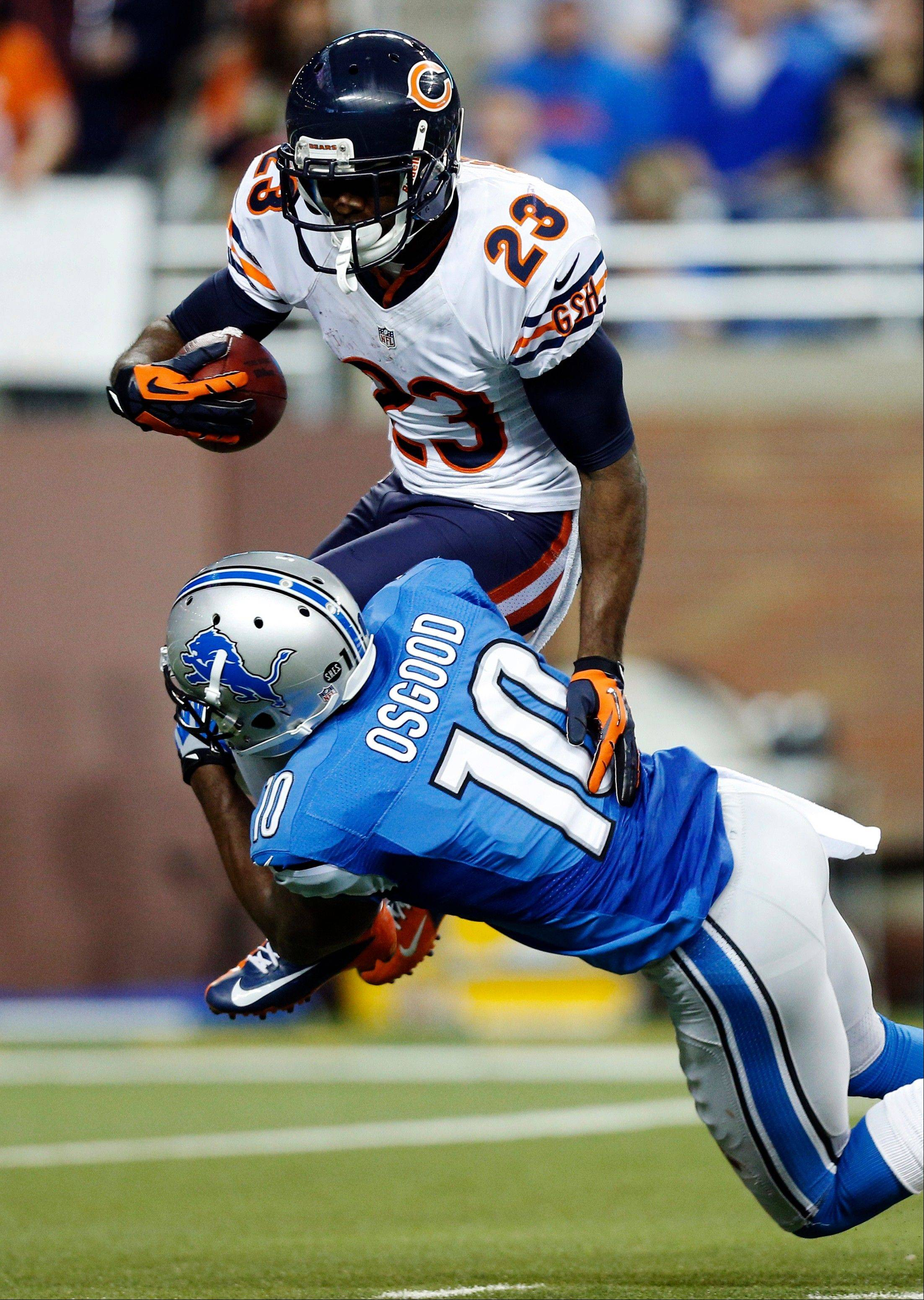 Chicago Bears' Devin Hester (23) is stopped by Detroit Lions' Kassim Osgood (10) during a kick return in the third quarter.