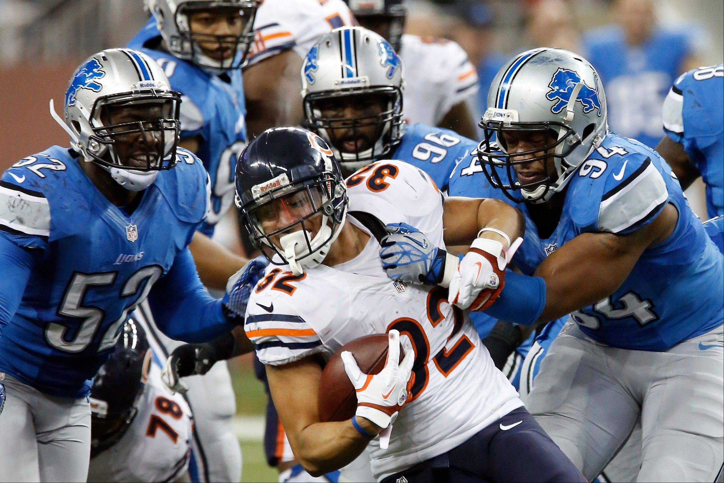 Chicago Bears running back Kahlil Bell (32) is stopped by Detroit Lions defensive end Lawrence Jackson (94) during the fourth quarter. The Bears won 26-24.