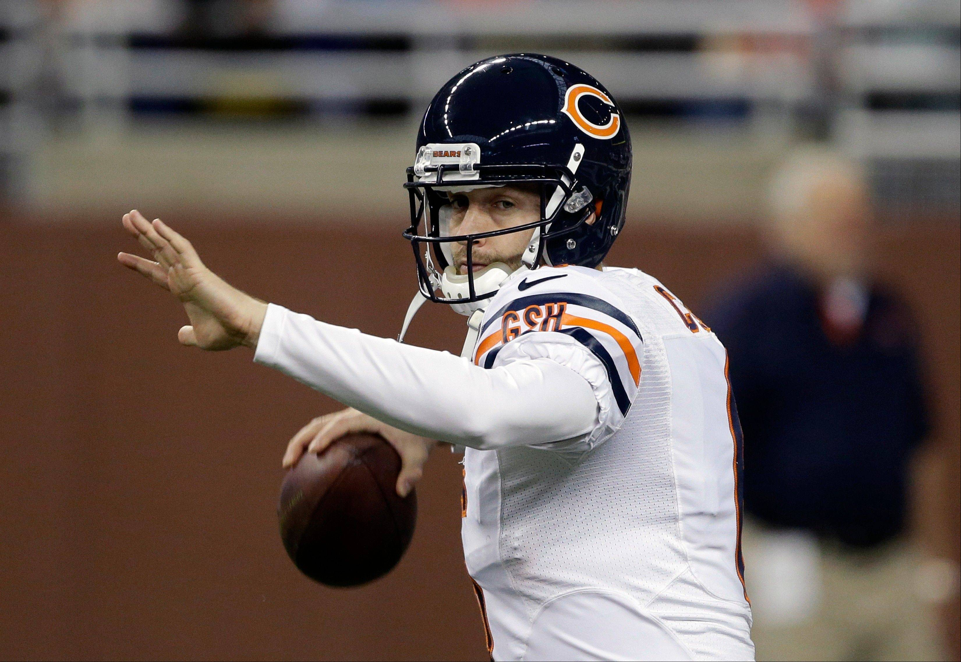 Chicago Bears quarterback Jay Cutler warms up before an NFL football game against the Detroit Lions at Ford Field.