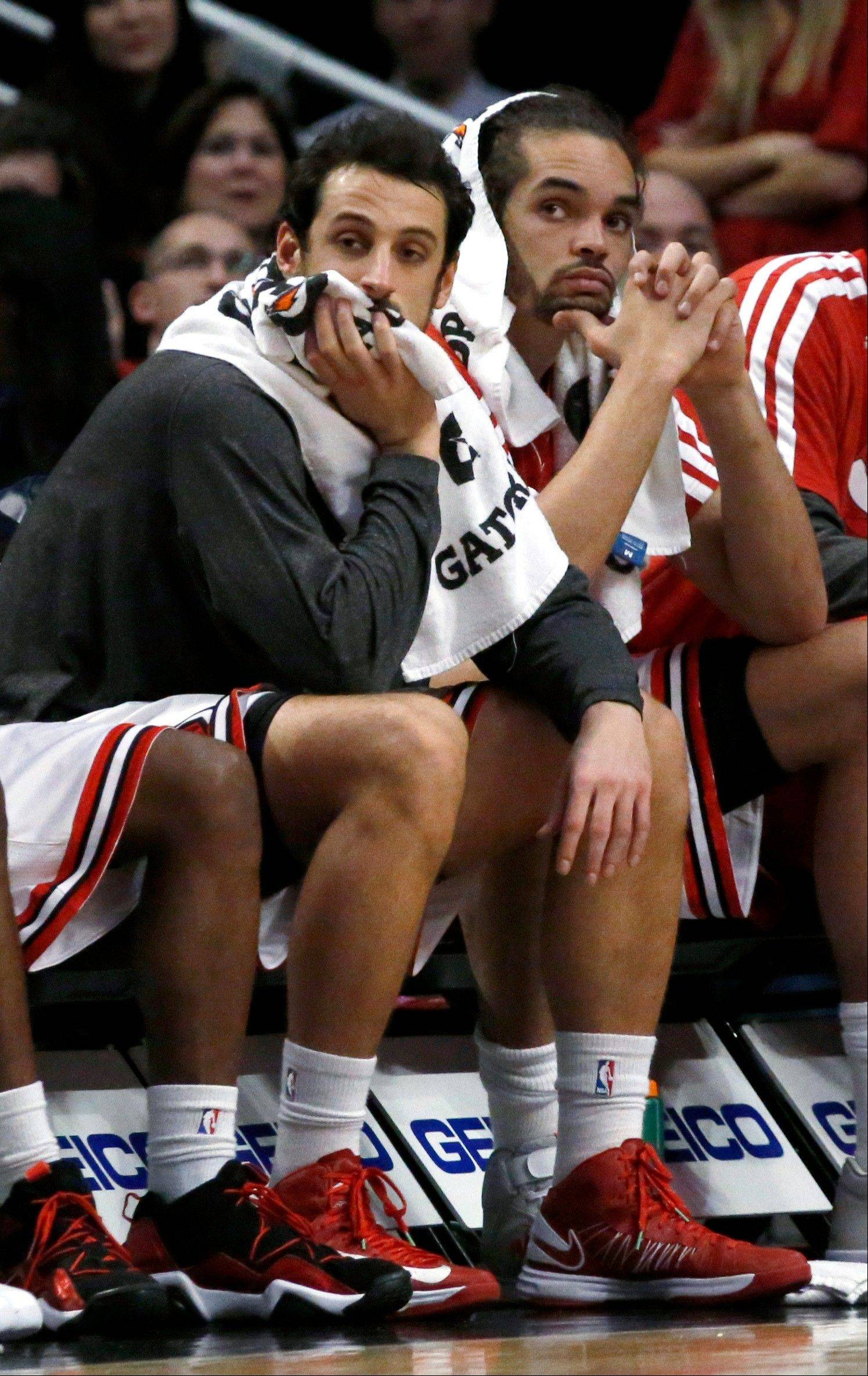 Marco Belinelli, left, and Joakim Noah sit on the bench during the closing seconds of the Bulls' 91-81 loss to Charlotte on Monday at the United Center.