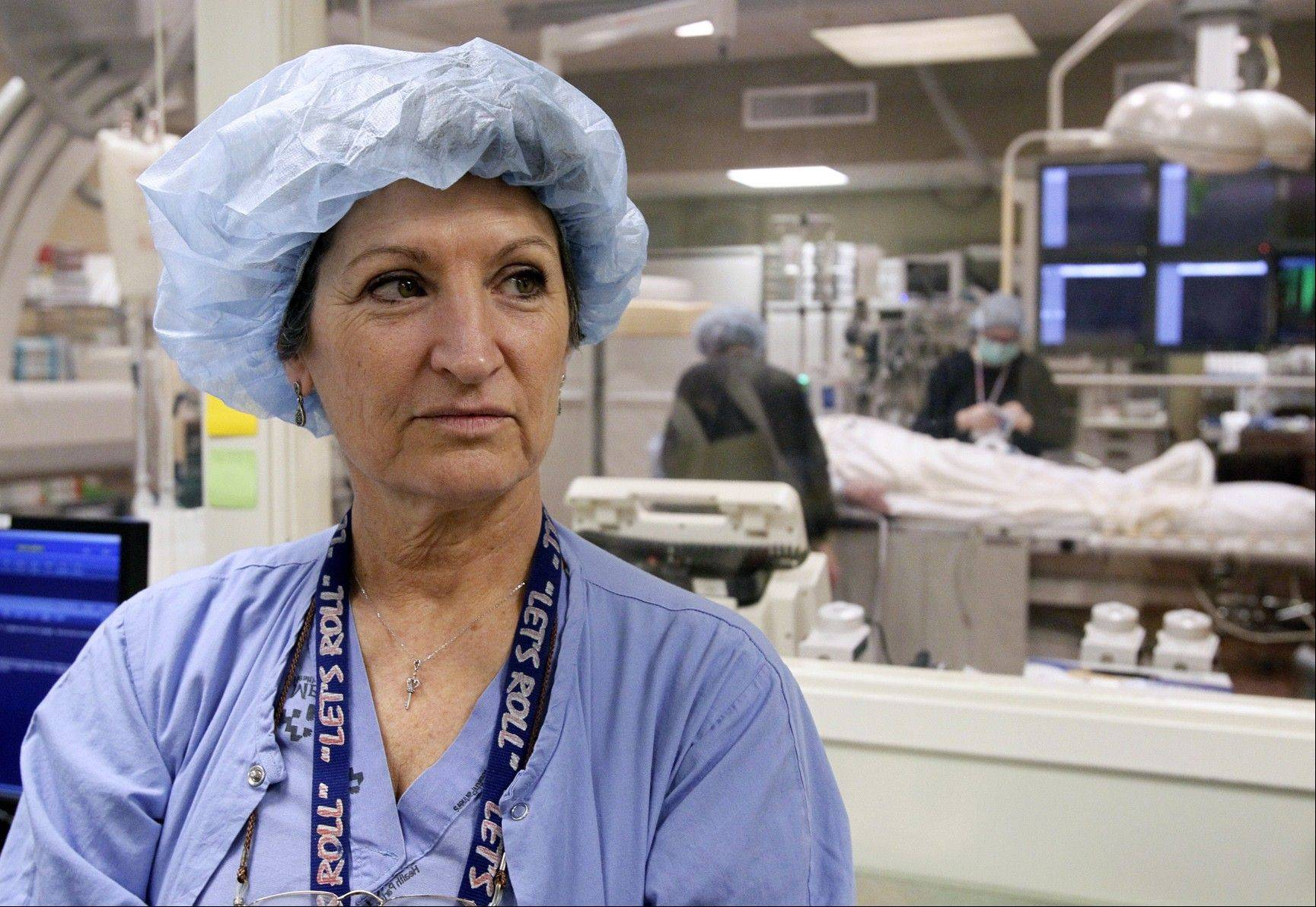 Olivia Cox, a registered nurse at Mercy St. Vincent hospital, returns to her job following a procedure for a cerebral aneurysm. She recently had aneurysm coiling, a minimally invasive endovascular procedure performed to treat the aneurysm.