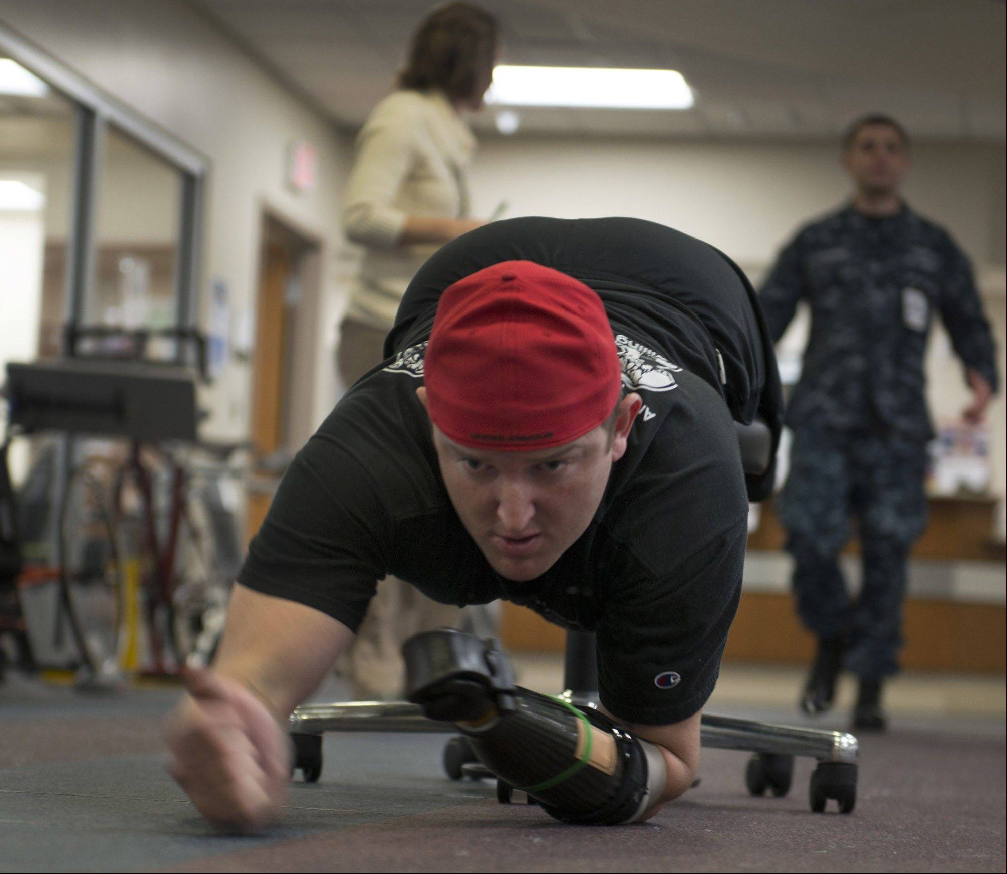 Sergeant Monte Bernardo exercises his upper body at the Walter Reed National Military Medical Center.