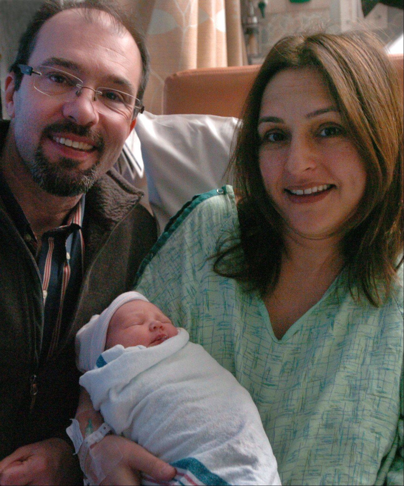 Hope Labbe, who was born at 12:13 a.m. Tuesday as the first baby in Northwest Cook County, rests with mother and father Fidan and Sean Labbe at St. Alexius Medical Center in Hoffman Estates.