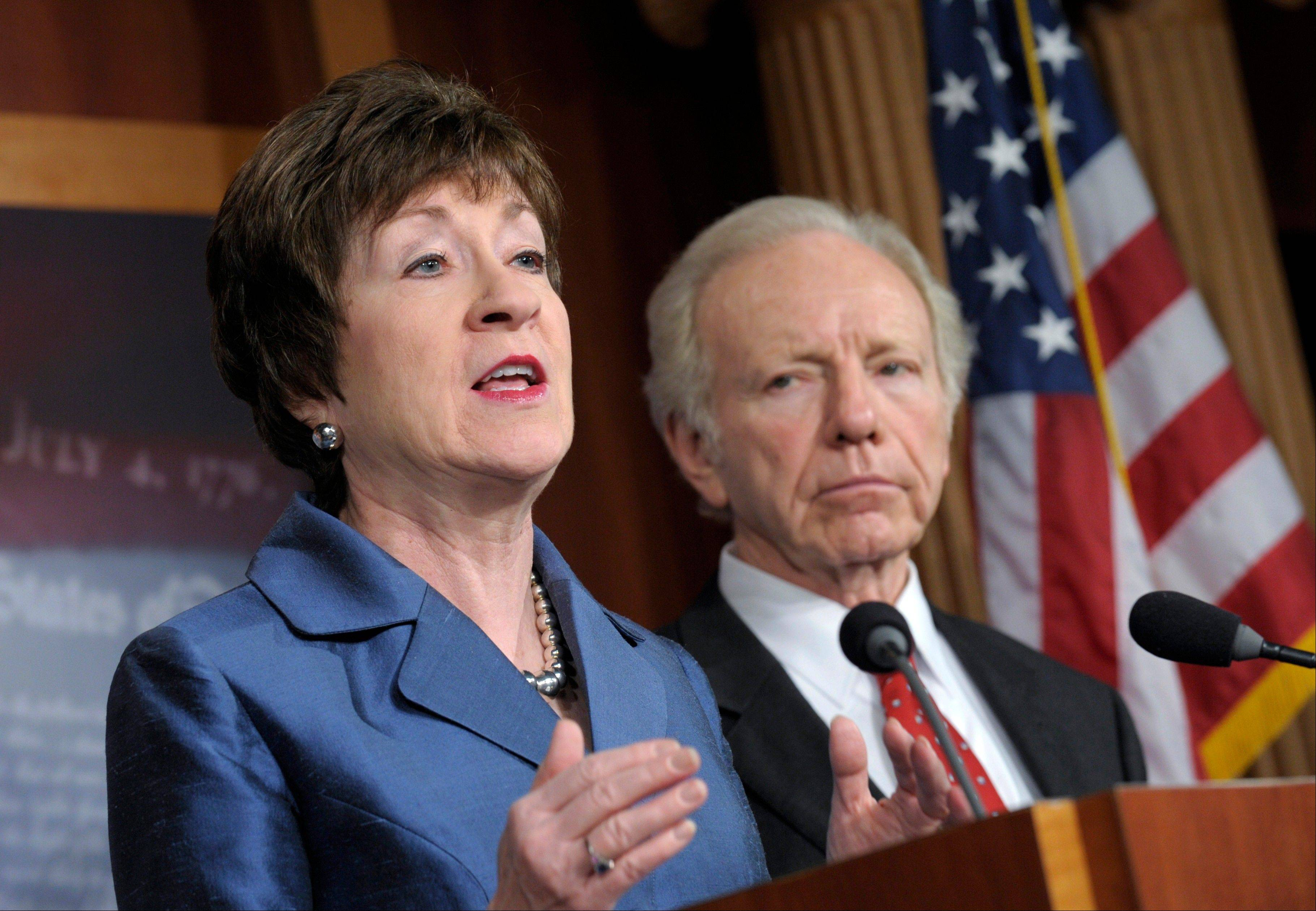 Senate Homeland Security Committee Chairman Sen. Joseph Lieberman listens at right, as the committee's ranking Republican, Sen. Susan Collins, speaks during a news conference on Capitol Hill Monday to discuss the committee's report on the security deficiencies at the U.S. Mission in Benghazi, Libya.