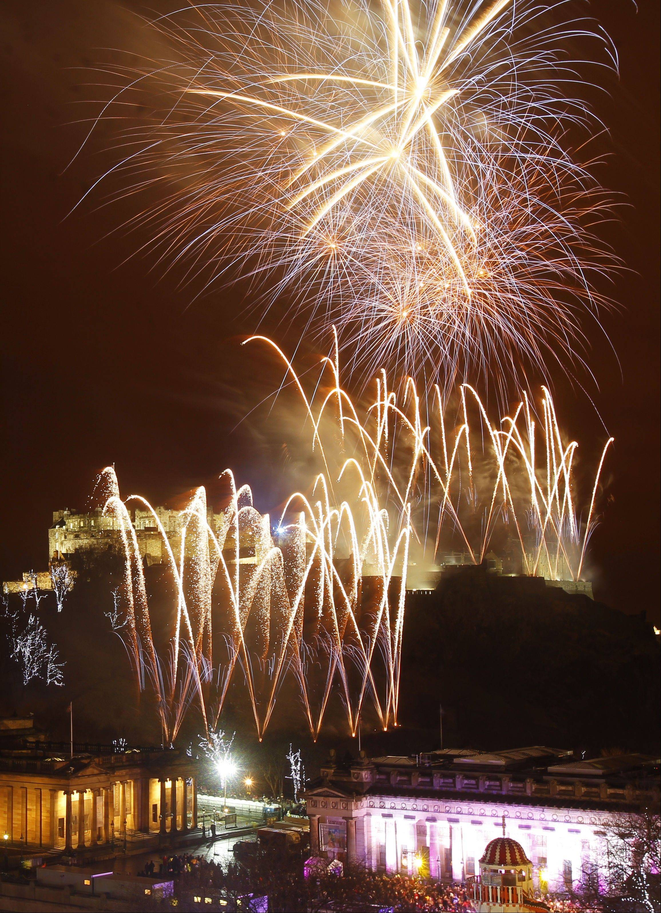 Fireworks go off over Edinburgh Castle, Scotland, as part of the New Year Hogmanay celebrations Monday Dec. 31, 2012.
