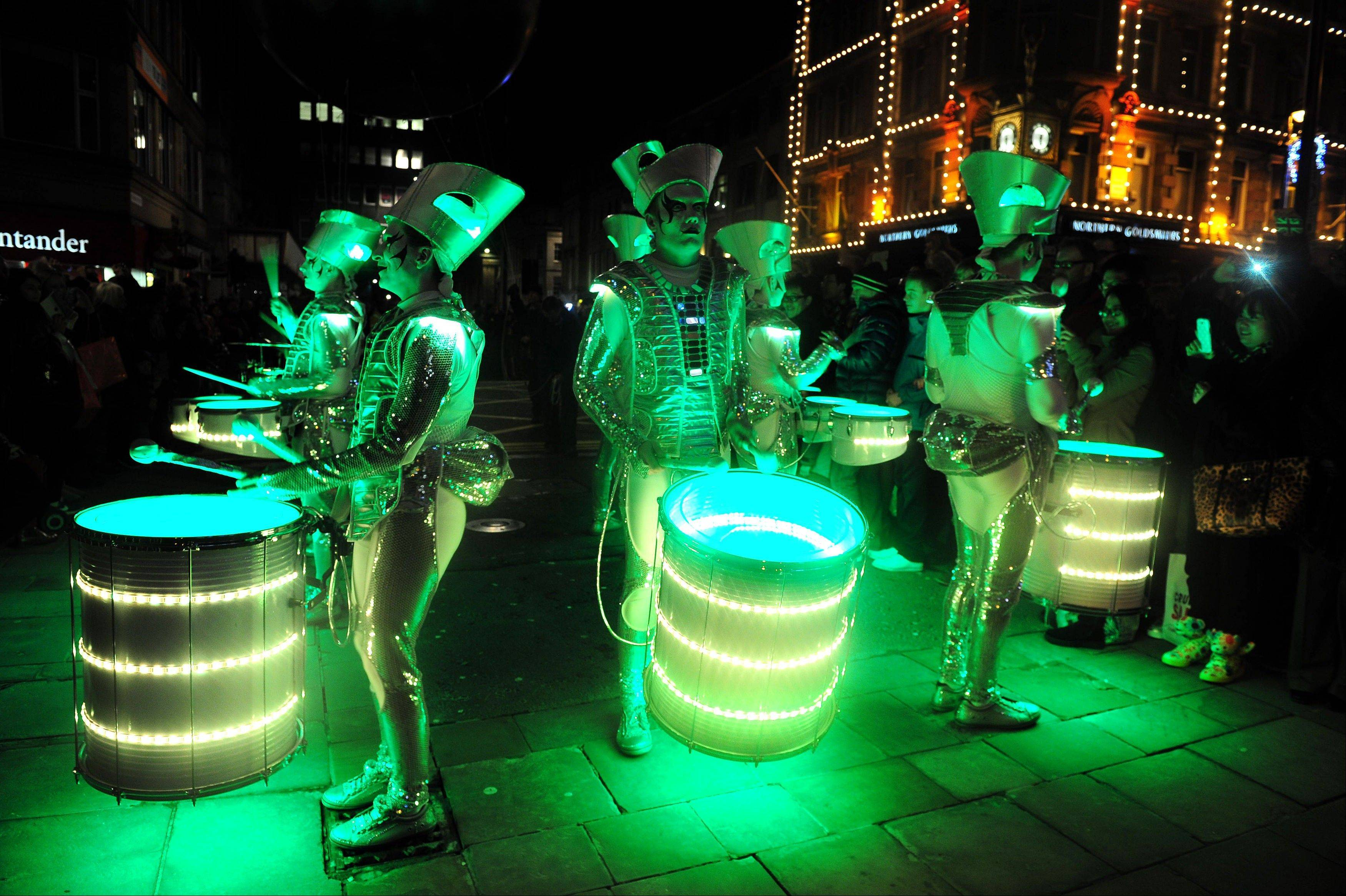 Celebrations get under way as the Spark drumming band pass through Newcastle city centre, England, Monday December 31, 2012.