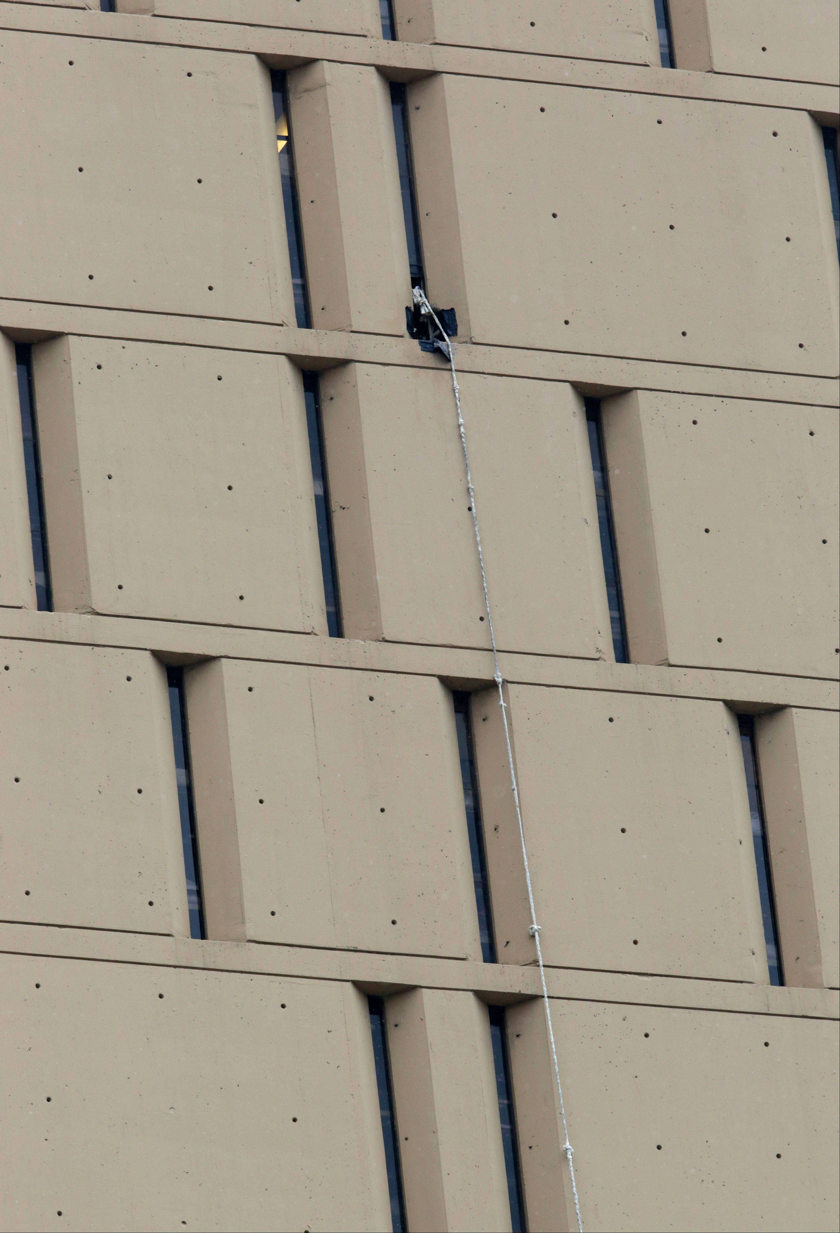 A rope dangles from a window on the back side of the Metropolitan Correctional Center on Dec. 18 in Chicago. Two convicted bank robbers used a knotted rope or bed sheets to escape.