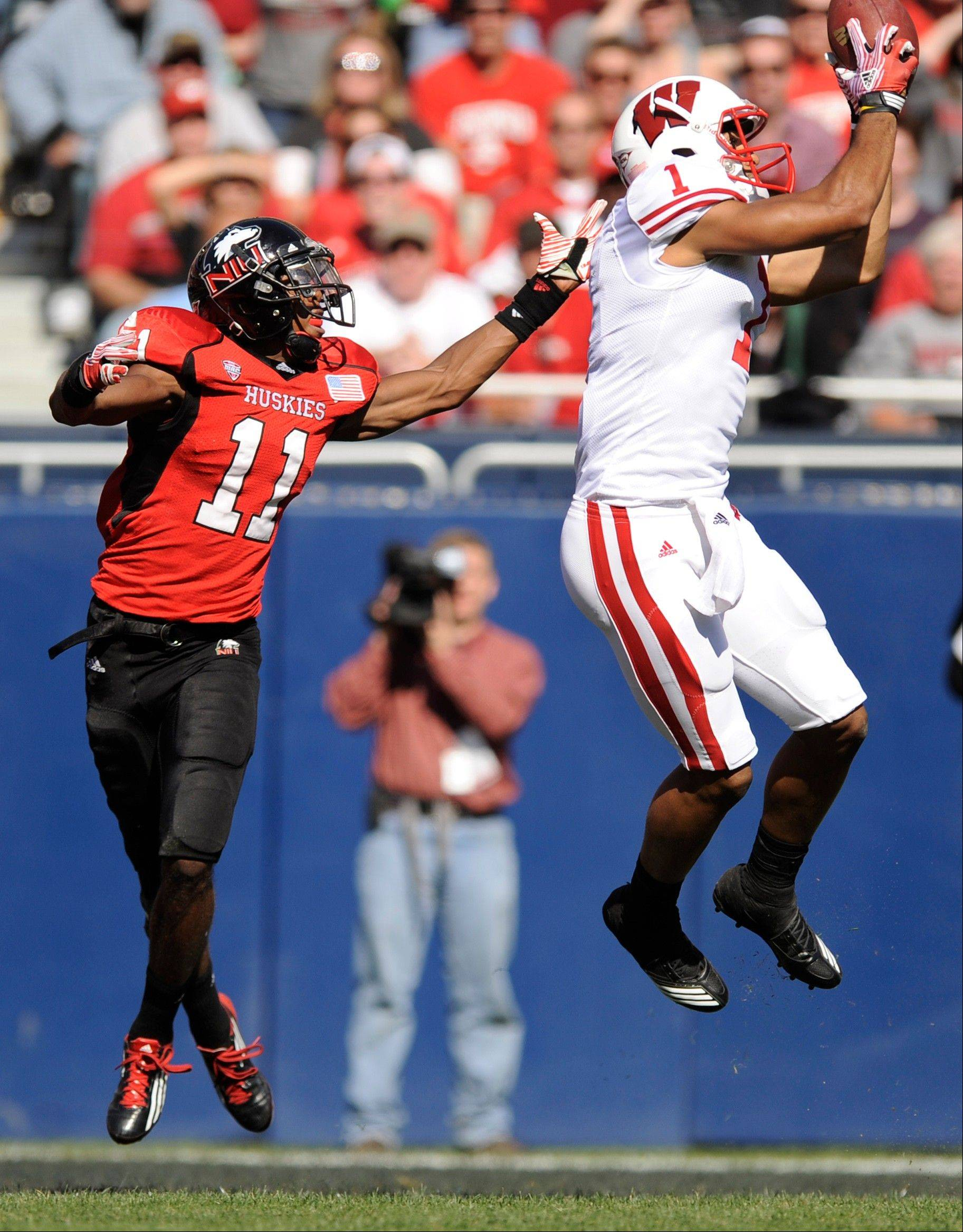 Wisconsin wide receiver Nick Toon, right, catches a touchdown pass in front of Northern Illinois' Rashann Melvin in Chicago, Saturday, Sept. 17, 2011. Wisconsin won 49-7. Melvin, a Waukegan grad, is listed on the 2012 NIU roster as a Cornerback.