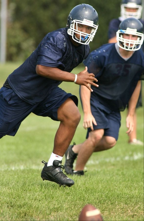 Alan Baxter practices during his high school days at Buffalo Grove. Baxter is listed on the 2012 NIU roster as a Defensive End.