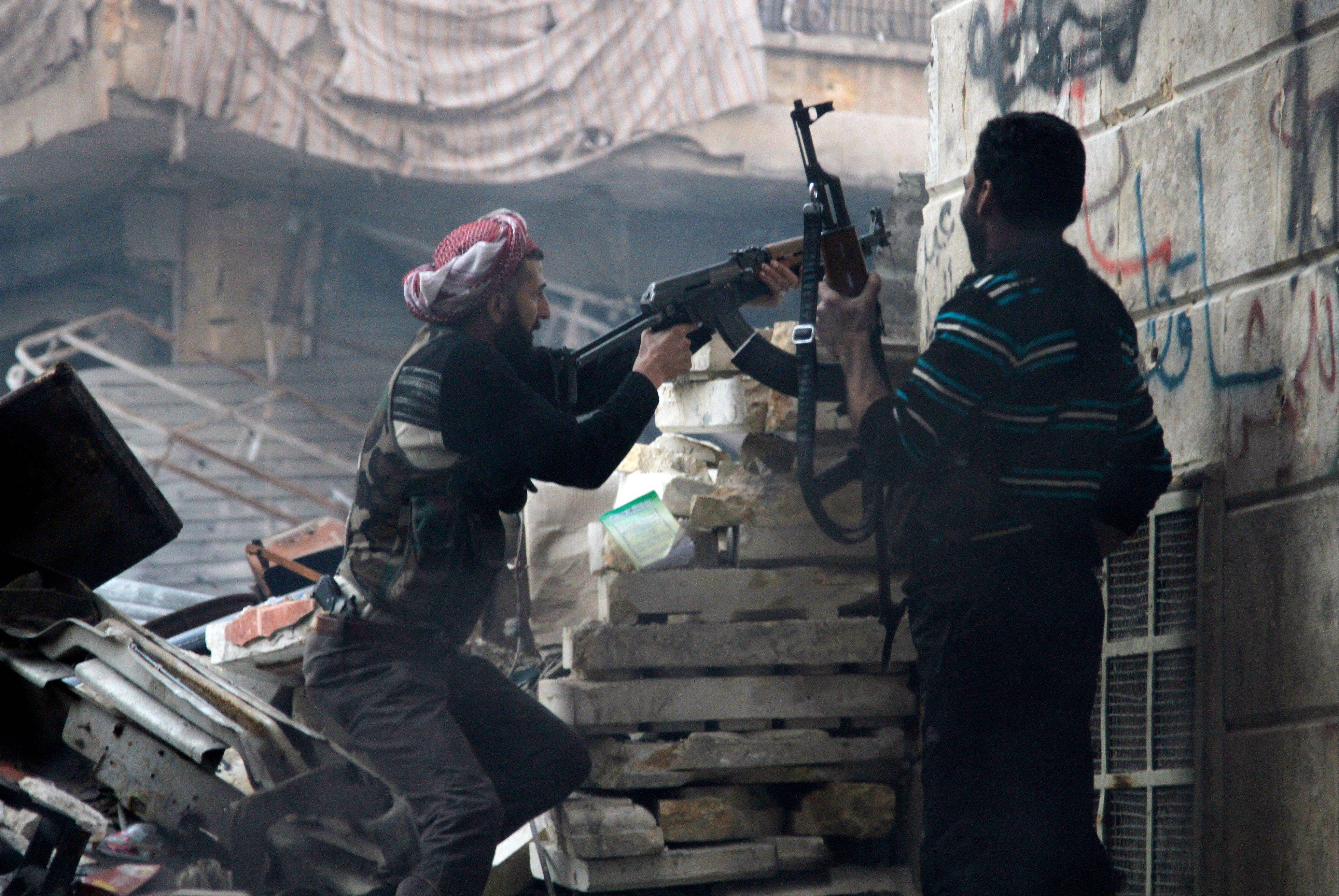 Free Syrian Army fighters fire at enemy positions during heavy clashes with government forces in the Salaheddine district in Aleppo, Syria. Activists say Syrian rebels have captured an oil pumping station in the north central province of Raqqa after days of fighting.