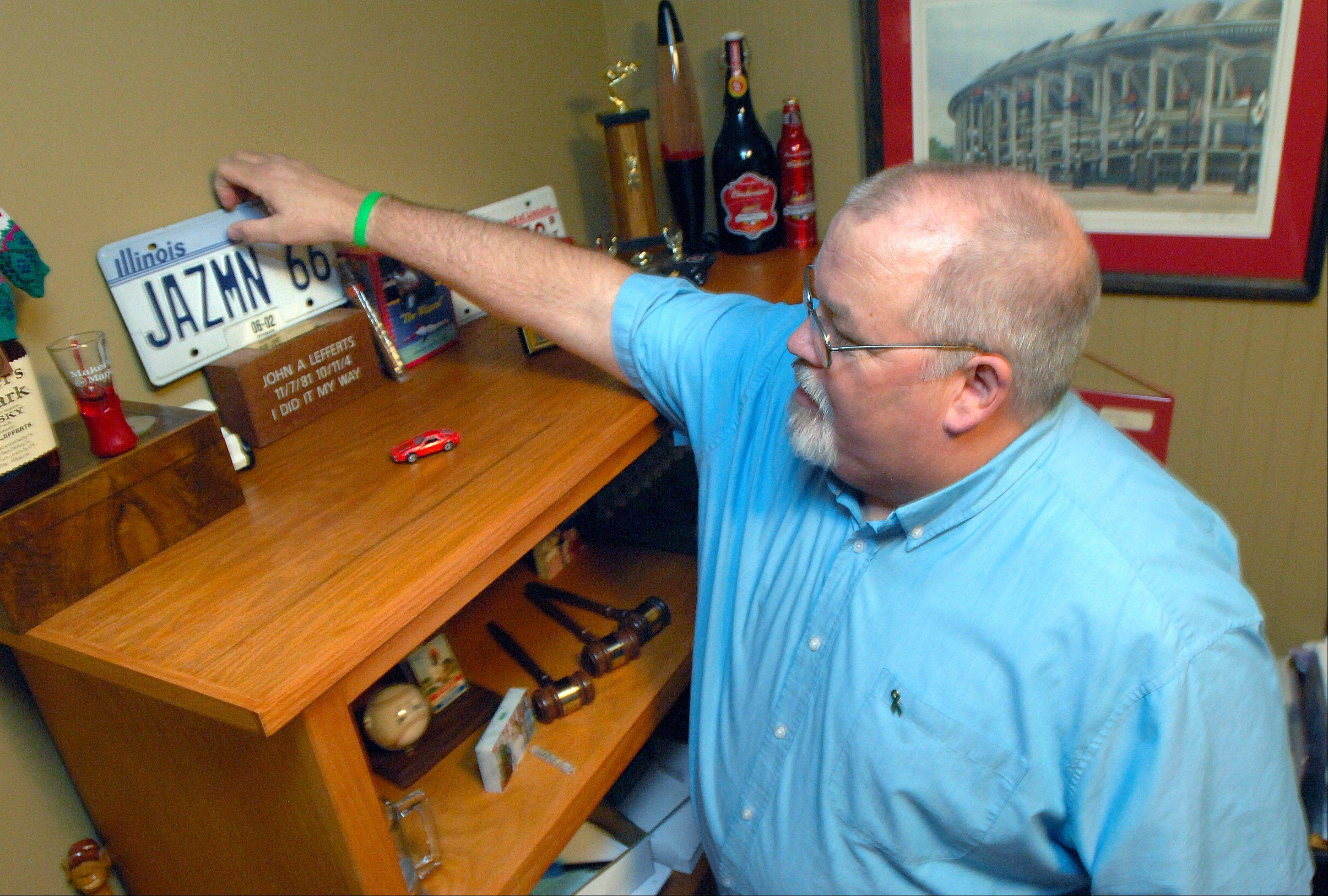 Larry Lefferts examines odds and ends that belonged to his son, John, on a bookcase in his office. John died suddenly and unexpectedly of an aortic dissection at age 22. More than 37 people have received tissue donations following his death. The Lefferts' believe that by choosing the path of tissue donation they are keeping their son's memory alive by helping others live.