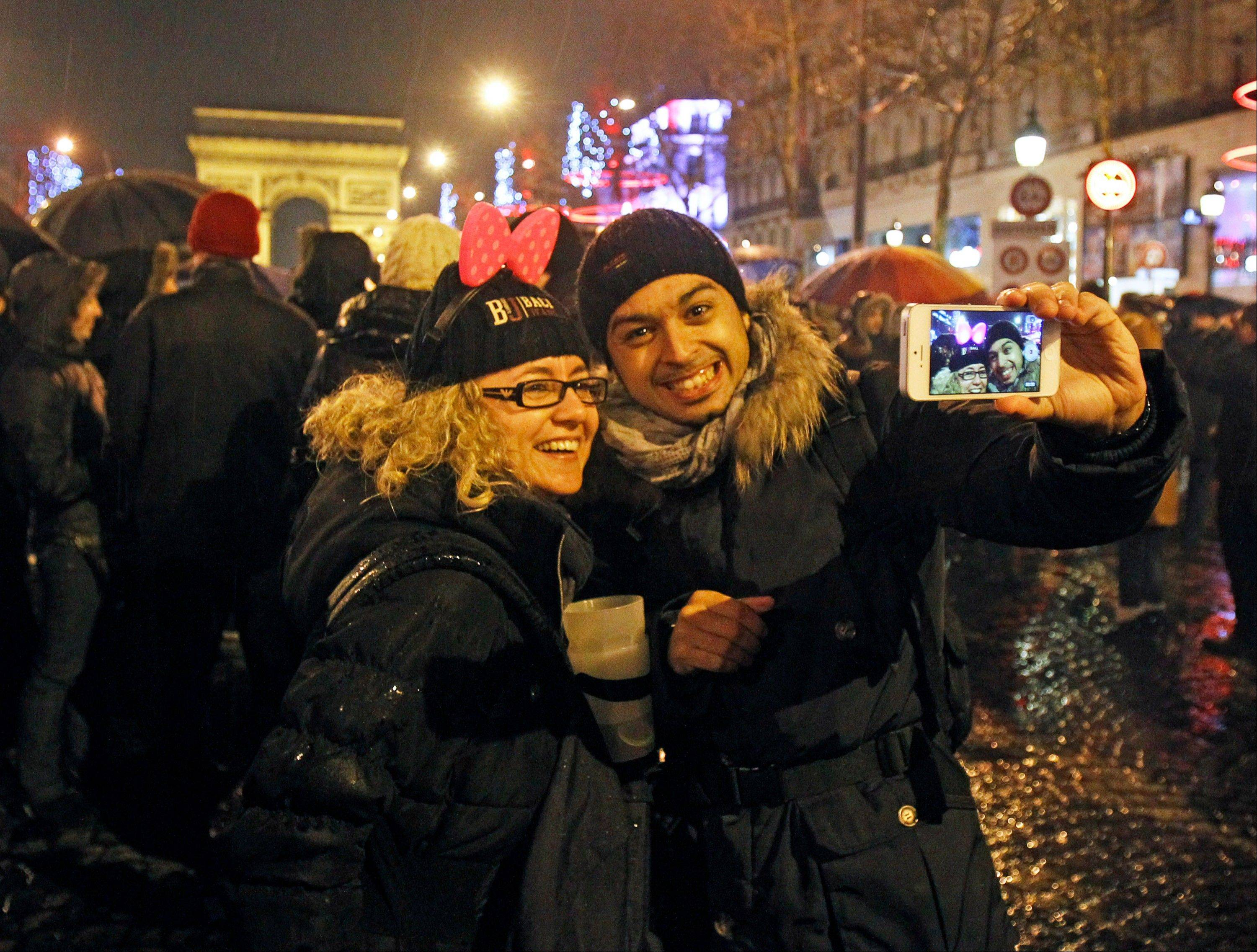 Revelers celebrate the new year on the Champs Elysee in Paris on Tuesday.