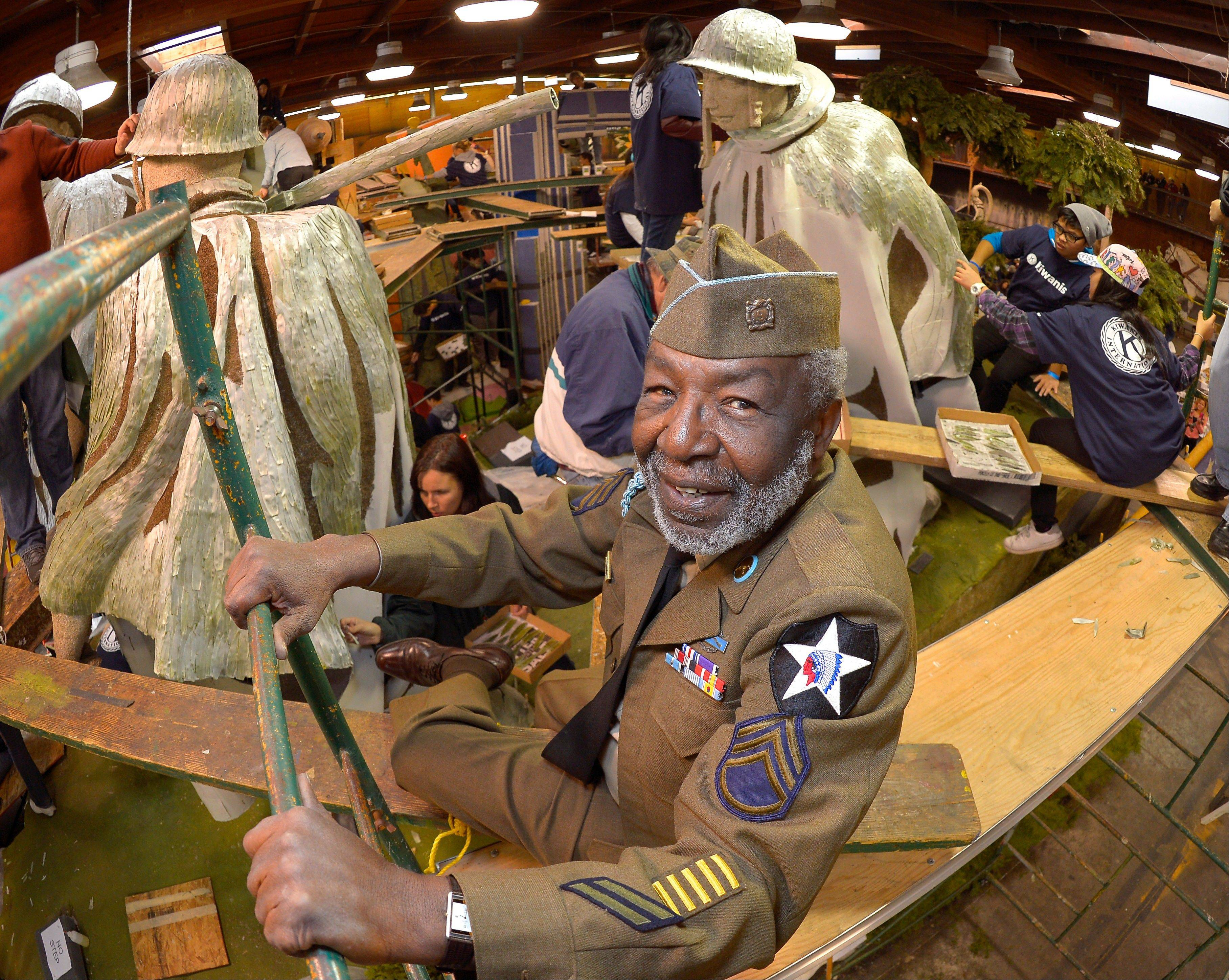 "Korean War veteran James McEachin, 82, shows off the Rose Parade float ""Freedom is not Free"" by the Korean War Commemoration Committee Saturday in Pasadena, Calif. McEachin is scheduled to ride the float in the Rose Parade on Tuesday."
