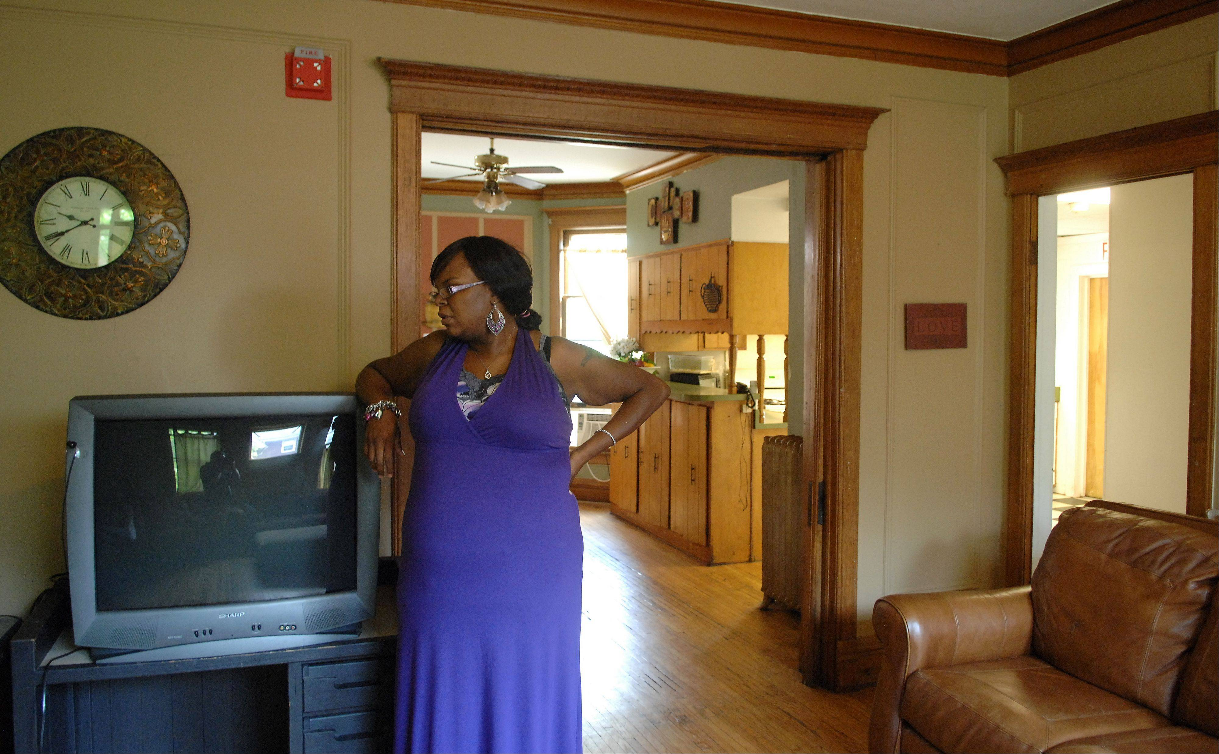 Andrea Johnson, a group home supervisor for the Larkin Center, stands in the living area of an Elgin group home that houses eight girls who have been the victims of physical, emotional and sexual abuse.