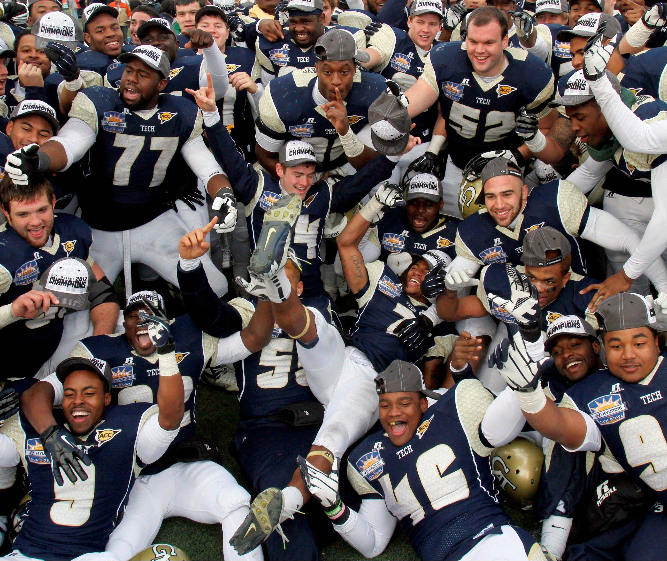 Georgia Tech players celebrate their 21-7 win over Southern California in the Sun Bowl on Monday in El Paso, Texas.