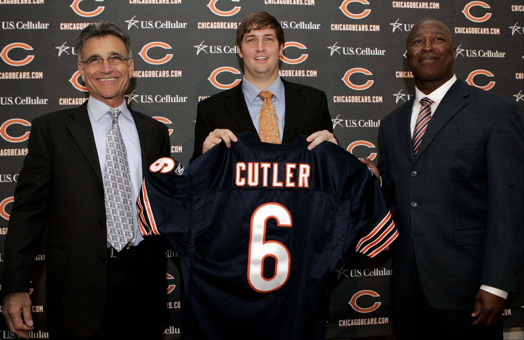 Chicago Bears general manager Jerry Angelo, left, new player Jay Cutler, center, and head coach Lovie Smith pose for a photo during a news conference, Friday, April 3, 2009, in Lake Forest, Ill.