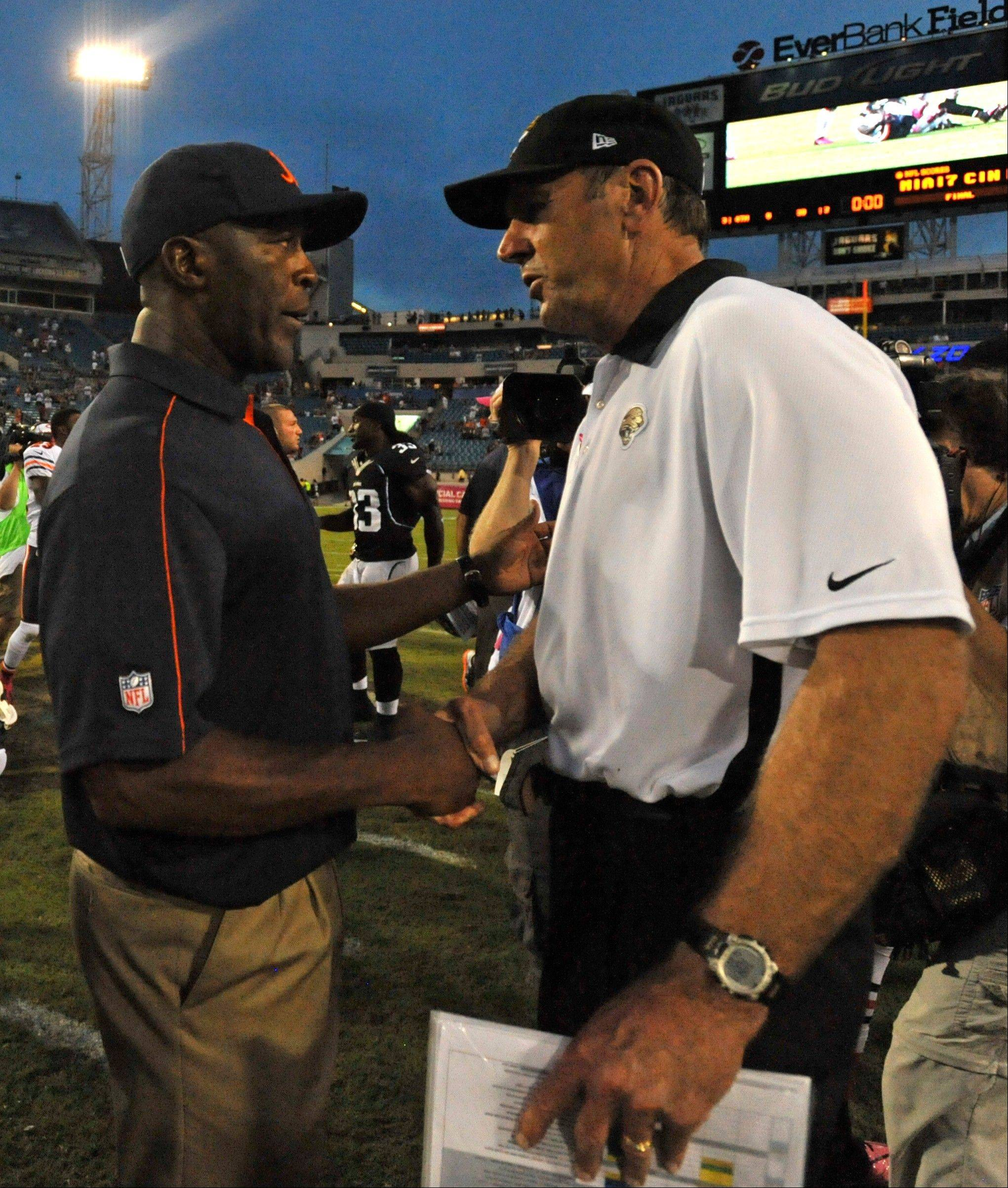Chicago Bears head coach Lovie Smith, left, and Jacksonville Jaguars head coach Mike Mularkey greet each other after an NFL football game, Sunday, Oct. 7, 2012, in Jacksonville, Fla. Chicago Bears beat the Jacksonville Jaguars 41-3.