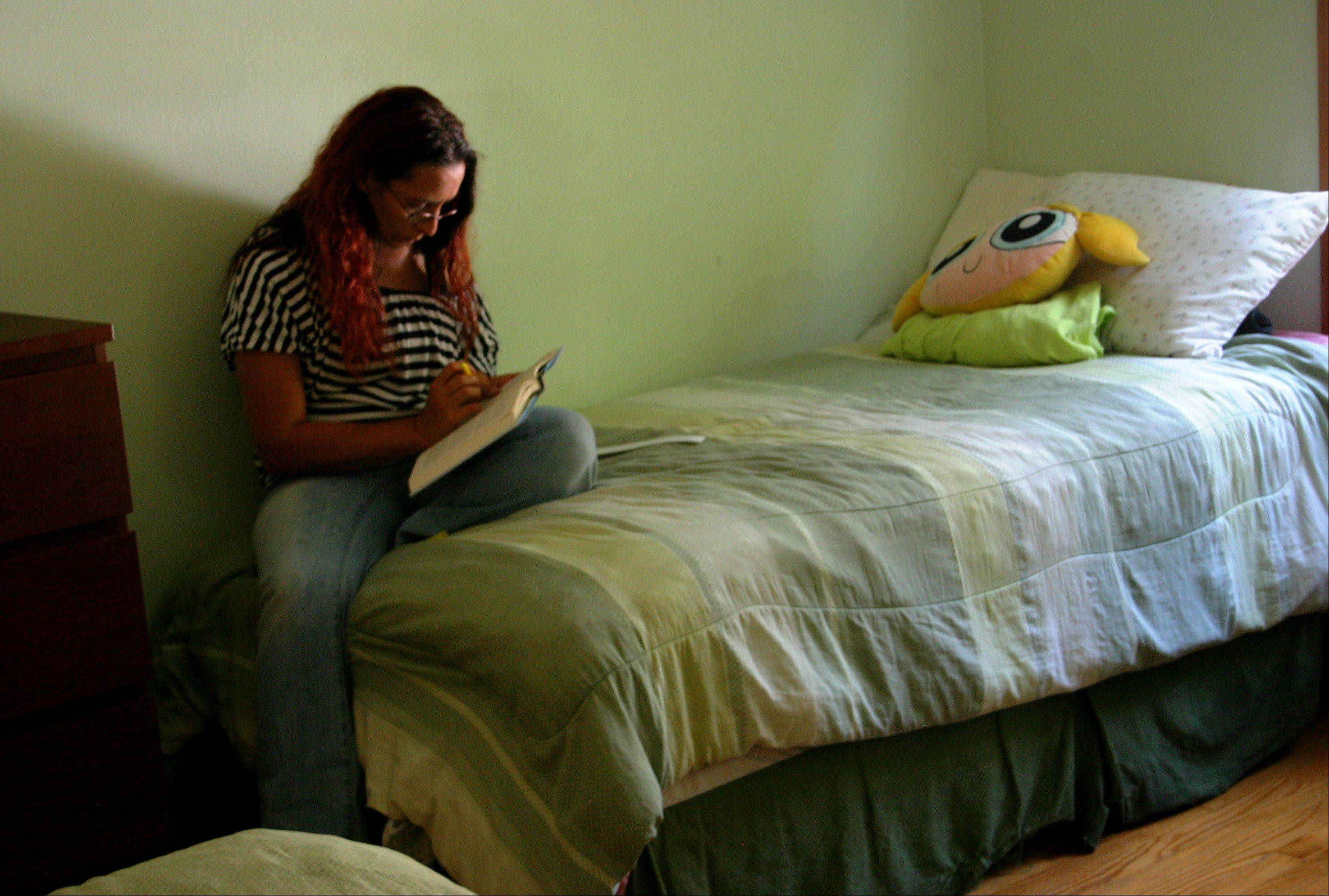 Lake County Haven resident reads on a bed at the shelter.