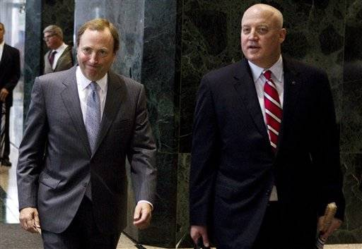 This Aug. 14, 2012, file photo shows NHL commissioner Gary Bettman, left, and Bill Daly, deputy commissioner and chief legal officer, following collective bargaining talks in Toronto.