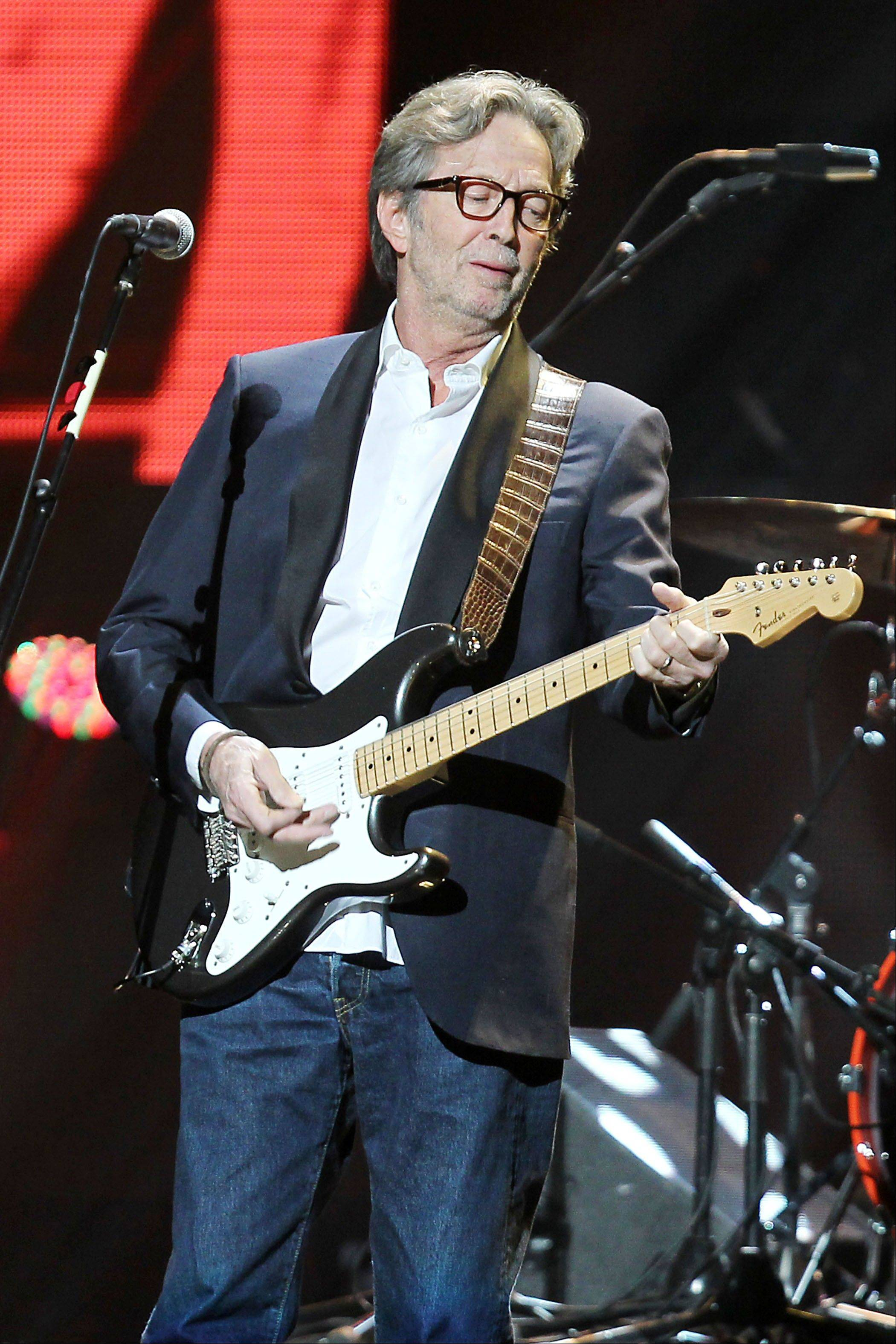 Starpix, Eric Clapton performs on stage at the 12-12-12 The Concert for Sandy Relief at Madison Square Garden in New York. The over $50 million in proceeds from the show were distributed through the Robin Hood Foundation to largely small, grassroots groups on the storm-devastated New York and New Jersey coastlines.